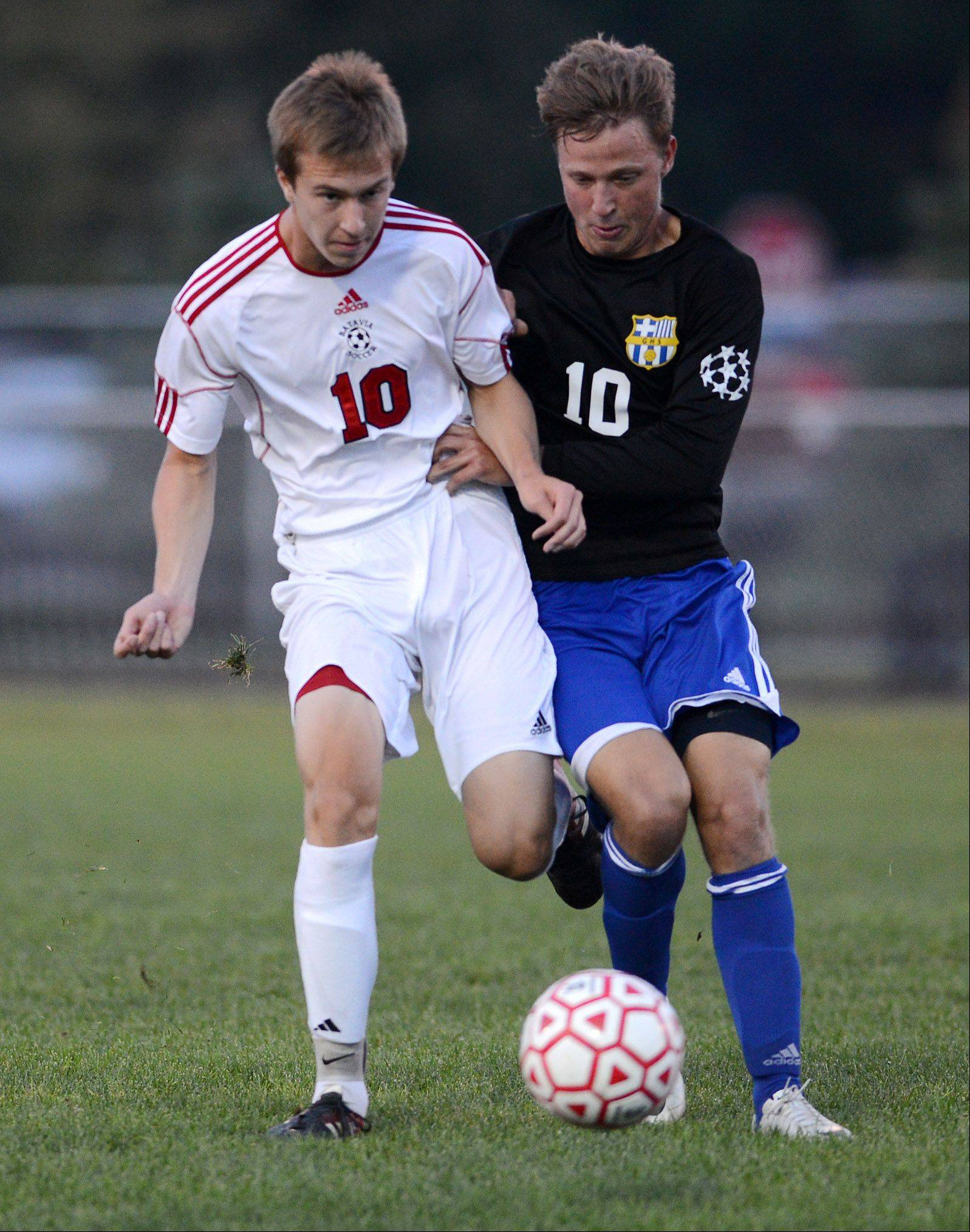 Batavia's Adam Heinz (10) battles Geneva's Beck Nebergall (10) for the ball.