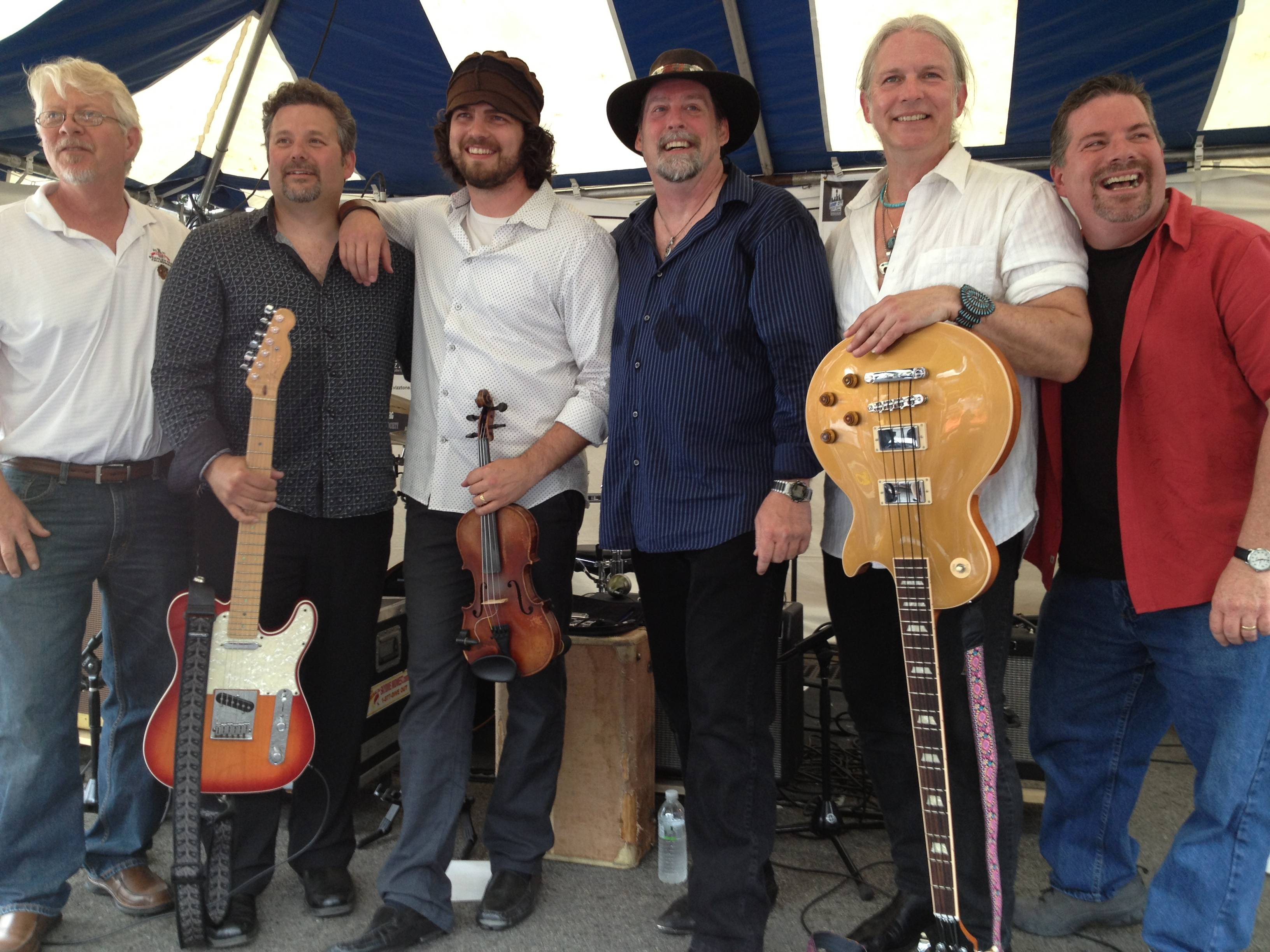 Photo taken at Chicago Blues Fest 2013. From left to right, Pete Kruse-drums, Don Laferty-guitar, Andy Ohlrich-fiddle, Kevin Purcell-harmonica & lead vocals, Tony Root-bass, Bill LeClair-keyboards.