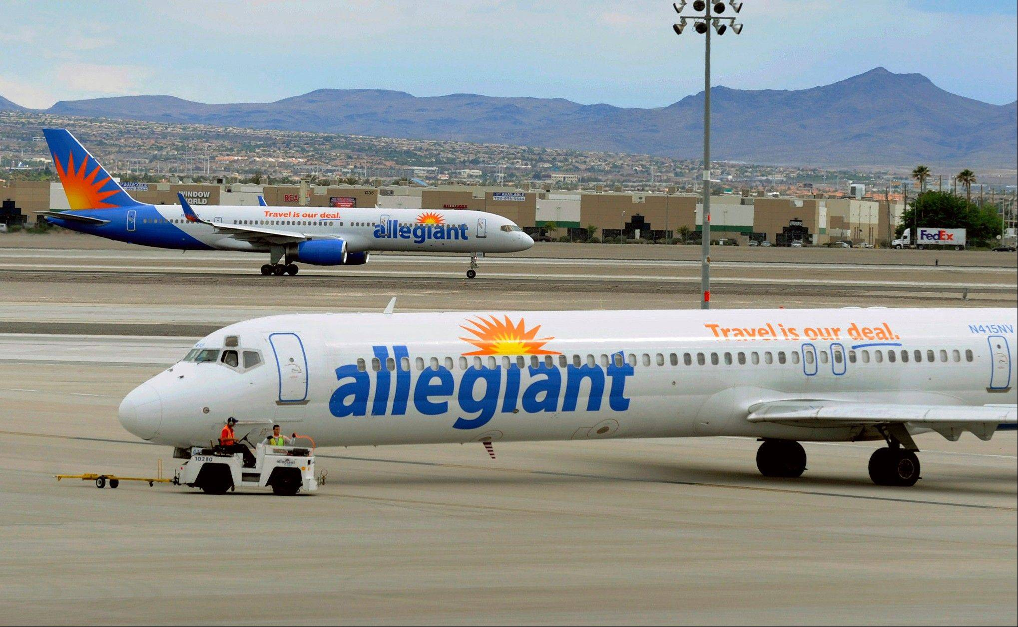 Two Allegiant Air jets taxi at McCarran International Airport in Las Vegas.