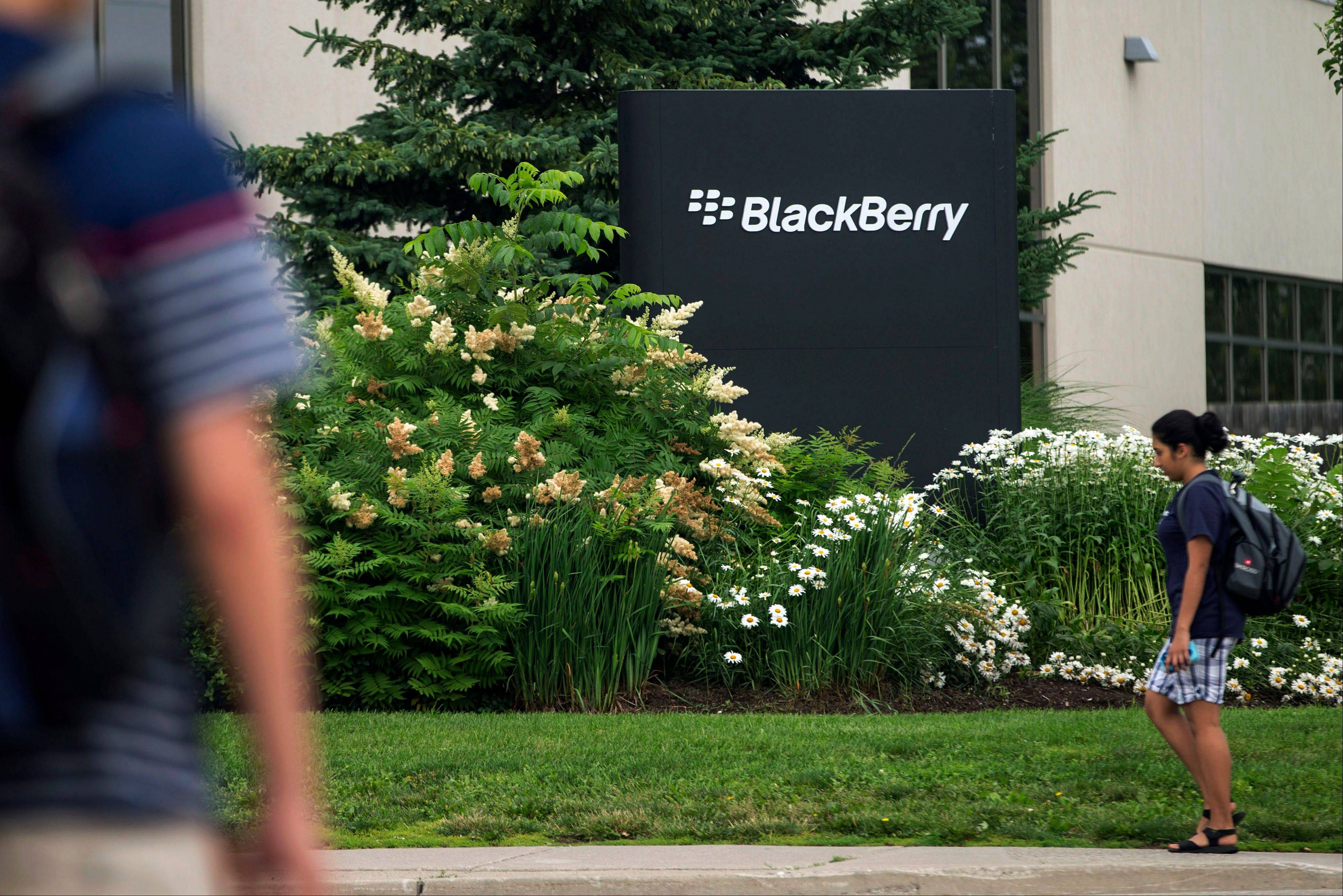 Associated Press/July 9 People walk near BlackBerry�s headquarters in Waterloo, Ontario.