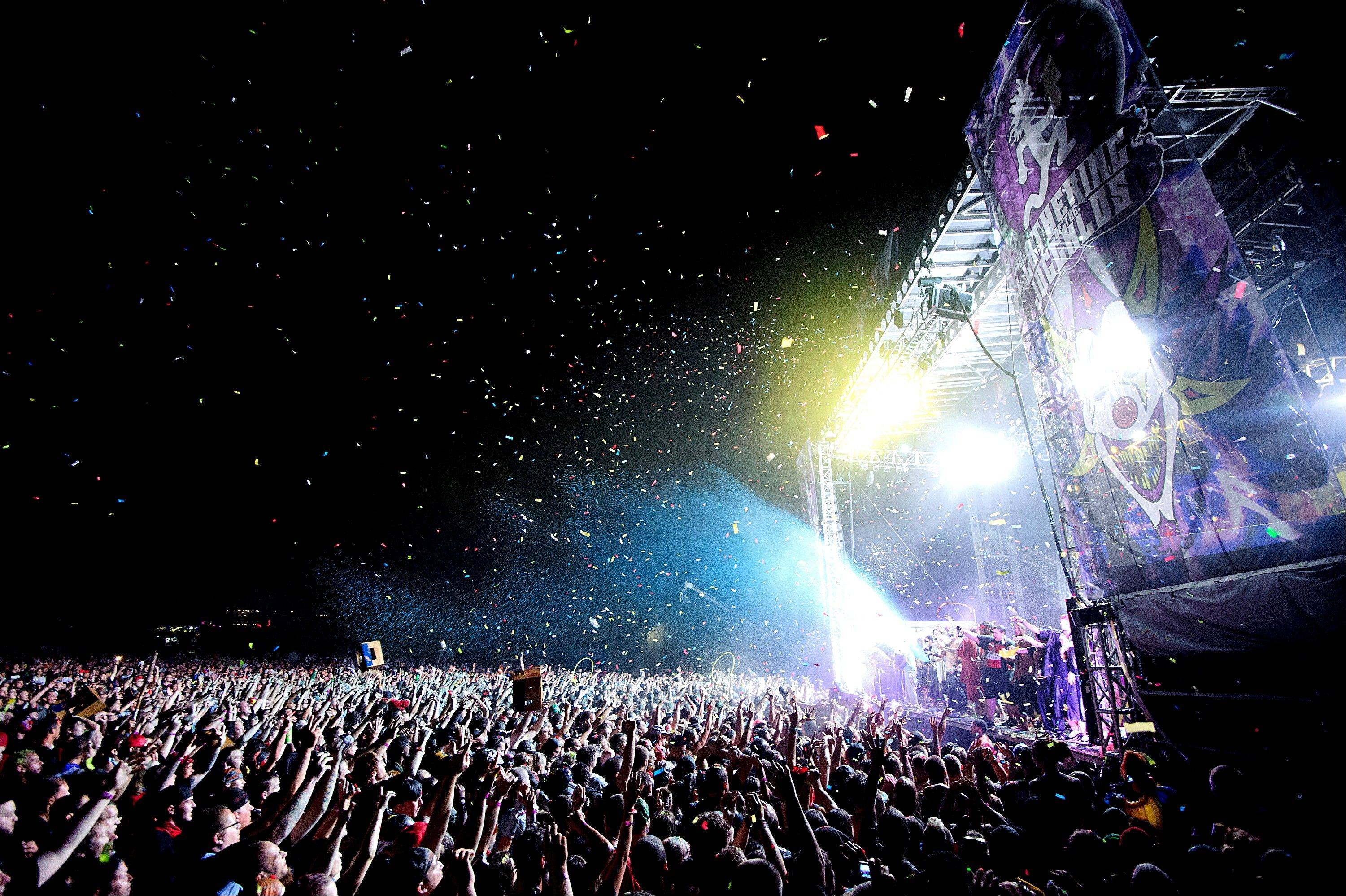 In this Aug. 11, 2012 photo, confetti is released over the crowd for the grand finale of I.C.P.�s headline performance on the final night of the Gathering of the Juggalos at Hogrock Campgrounds in Cave-In-Rock, Ill. Vendors at this year�s outdoor festival featuring rap-metal group Insane Clown Posse are complaining they�re owed thousands of dollars by promoters of the southern Illinois event, who now pledge they�ll find a way to pay the tab.