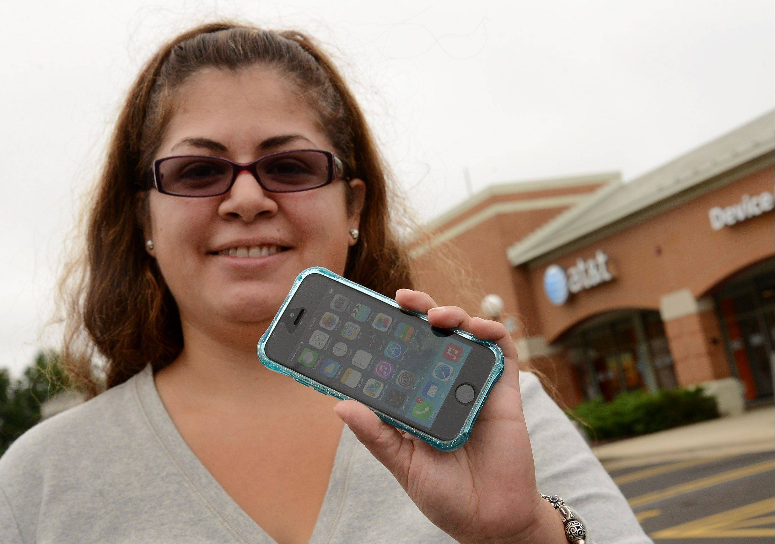 Jenny Beltran of Hoffman Estates purchased her new iPhone 5 s at the ATT store in Schaumburg, after breaking her old one she owned for four years.