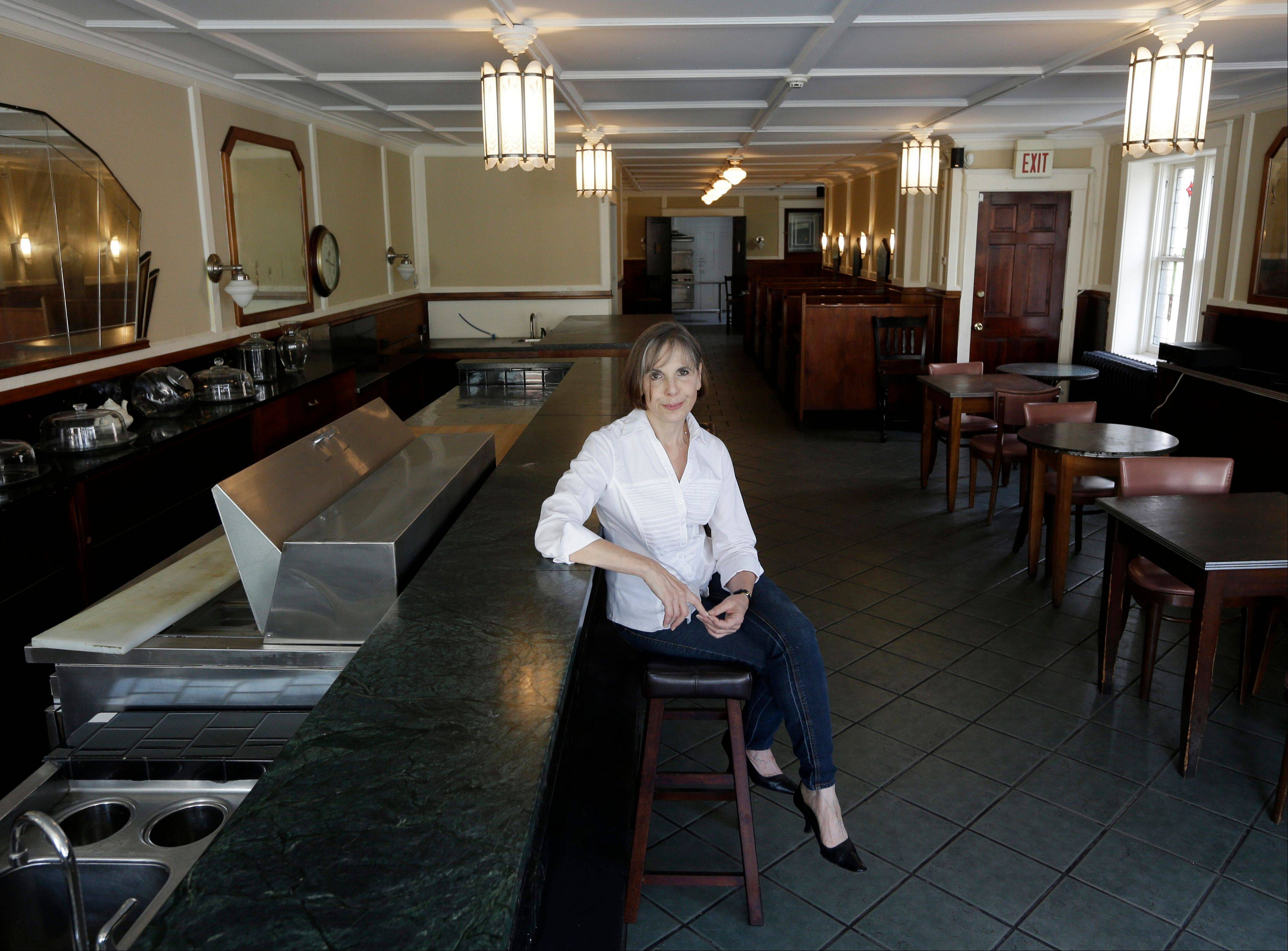 Nina Sklansky sits in an empty restaurant in Catskill, N.Y. Her group is looking for a buzz-worthy, foodie-friendly restaurant in this Hudson River village and are offering the right chef the Main Street space free rent for a year.