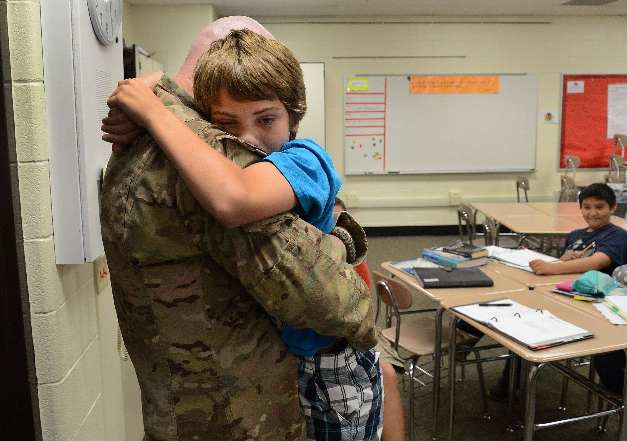 Navy Chief Gunner�s Mate Patrick Fissette surprises his son, Tristan, at Mead Junior High School in Elk Grove Village Friday after returning home from his last tour of duty.