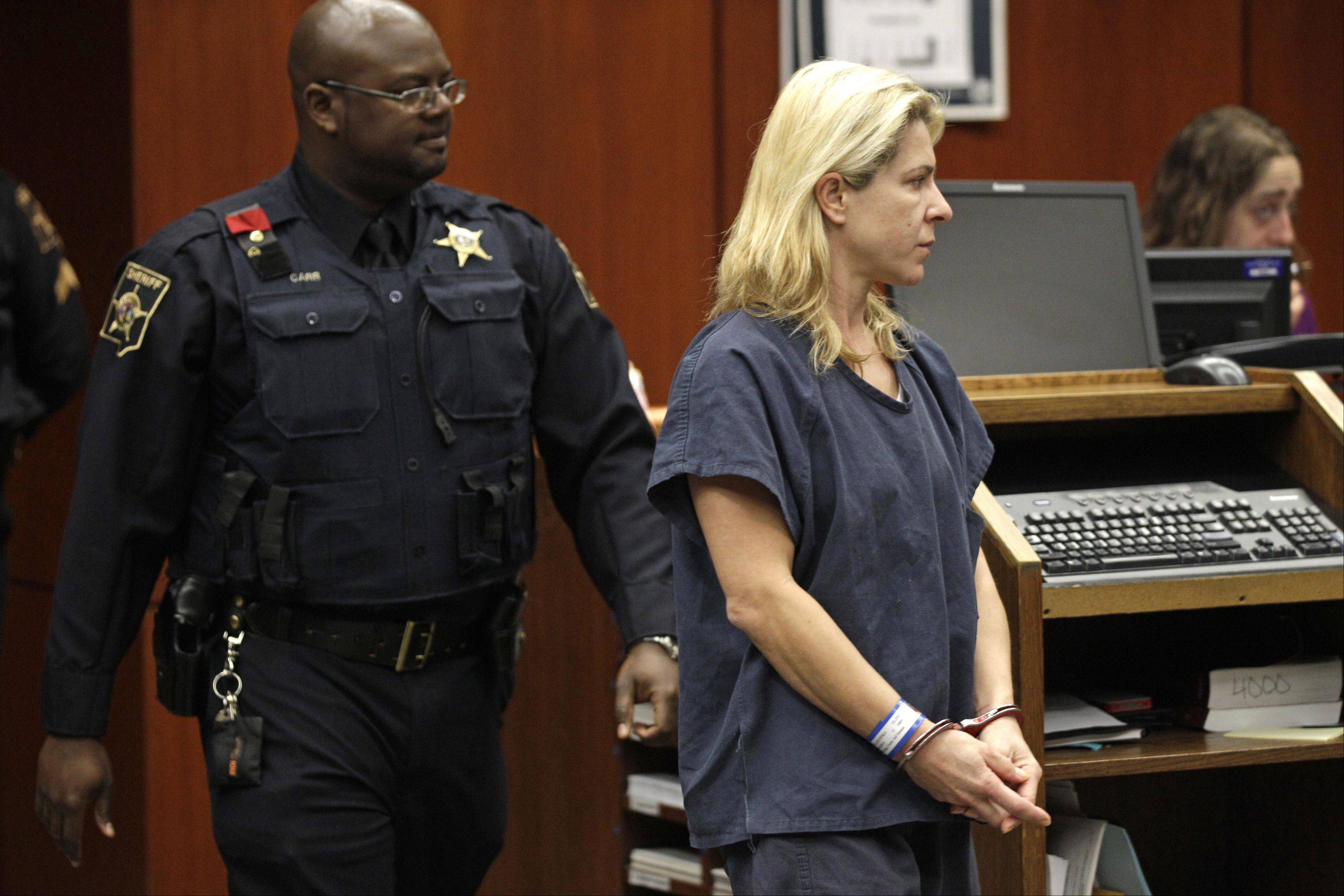 Psych exam under way for Naperville mom charged in child slayings