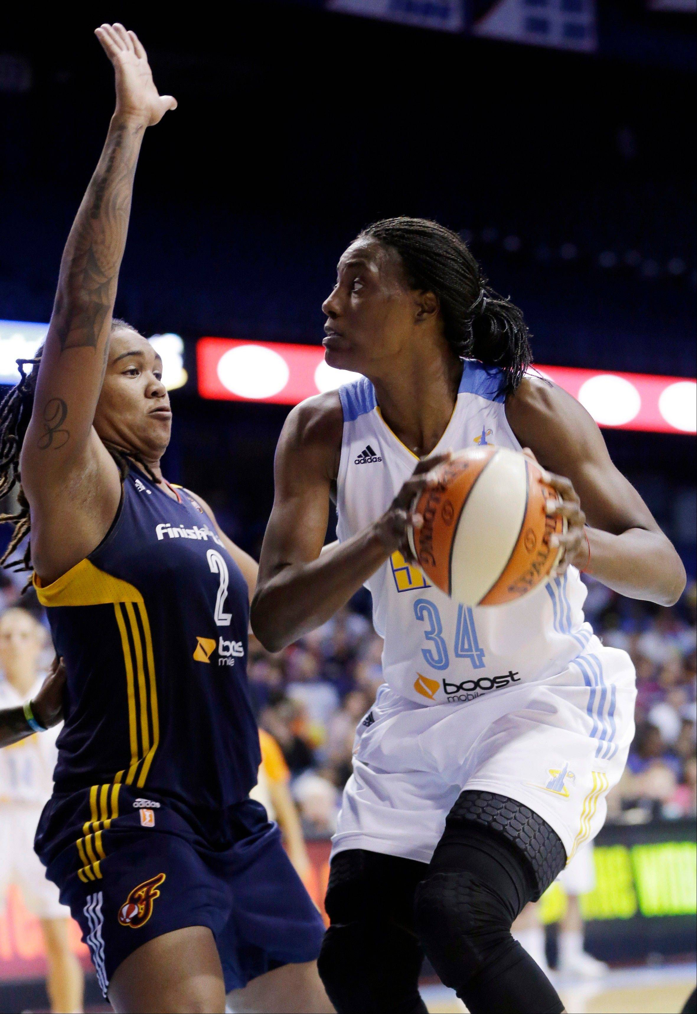 Indiana Fever center Erlana Larkins, left, guards Chicago Sky center Sylvia Fowles during the second half in Game 1 of the WNBA basketball Eastern Conference semifinal series on Friday, Sept. 20, 2013, in Rosemont, Ill. The Fever won 85-72.