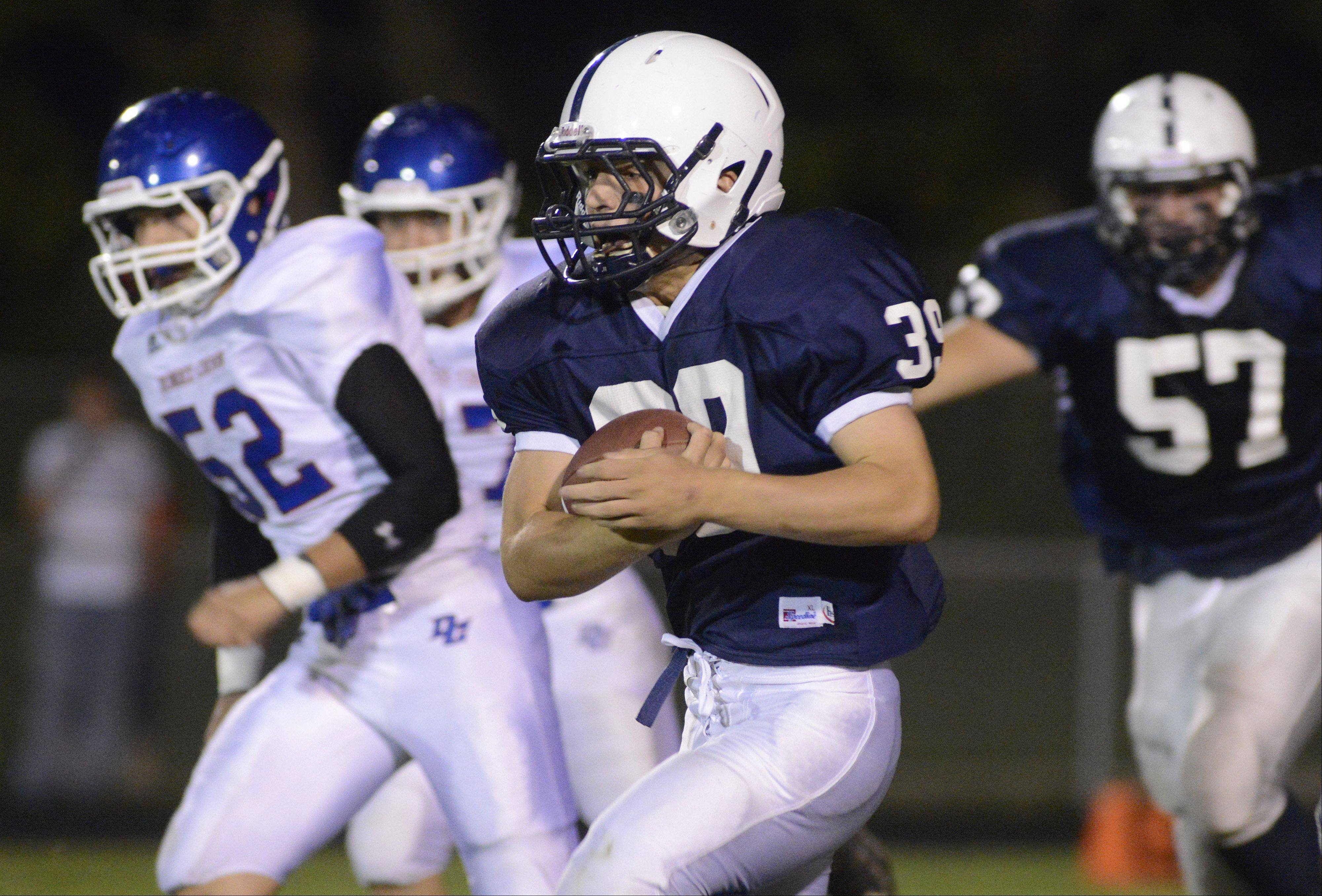 Cary-Grove�s Tyler Pennington makes his way down the field in the first quarter against Dundee-Crown on Friday in Cary.