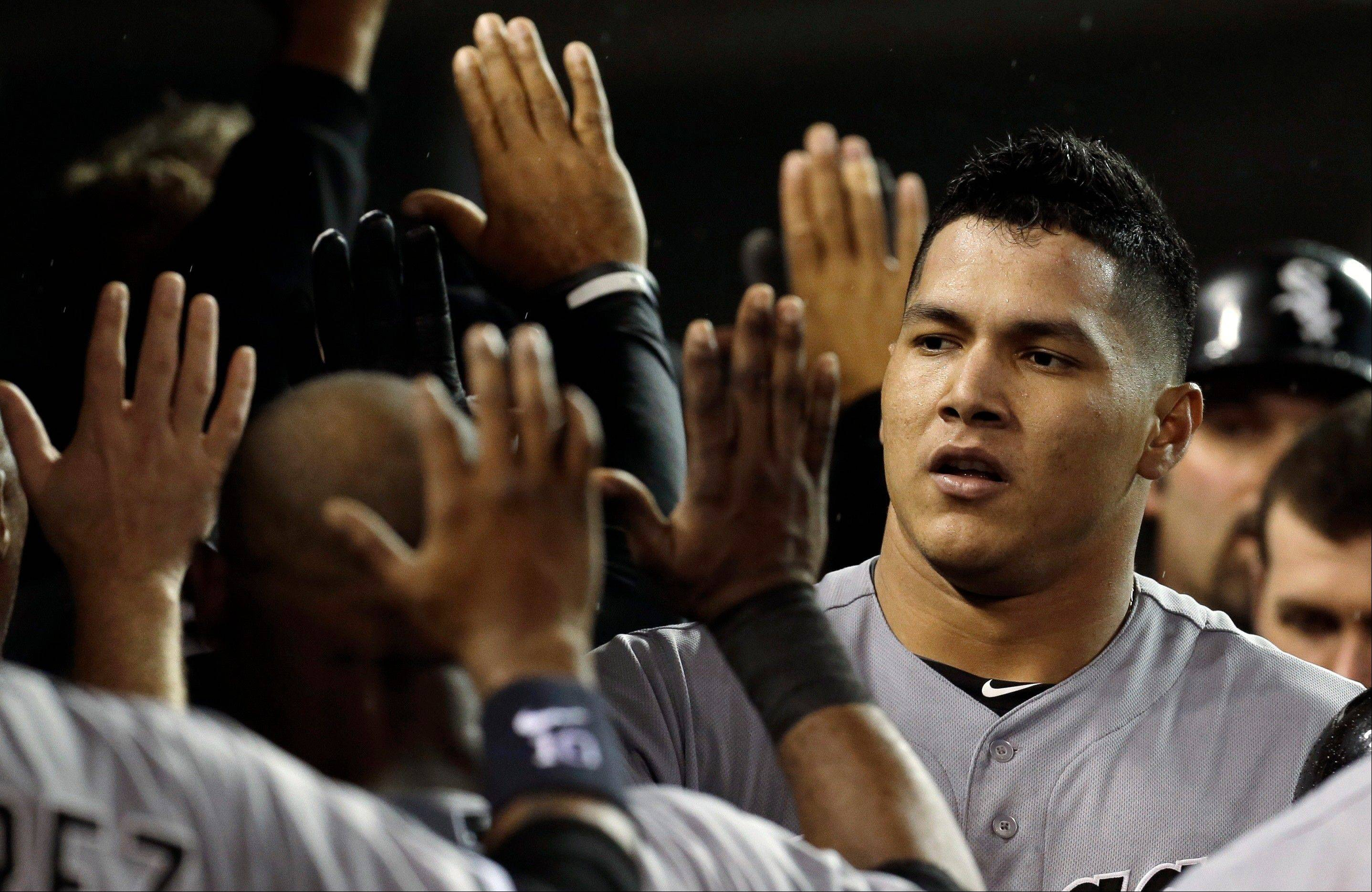 Chicago White Sox's Avisail Garcia celebrates his two-run home run against the Detroit Tigers in the fourth inning of a baseball game in Detroit, Friday, Sept. 20, 2013. (AP Photo/Paul Sancya)