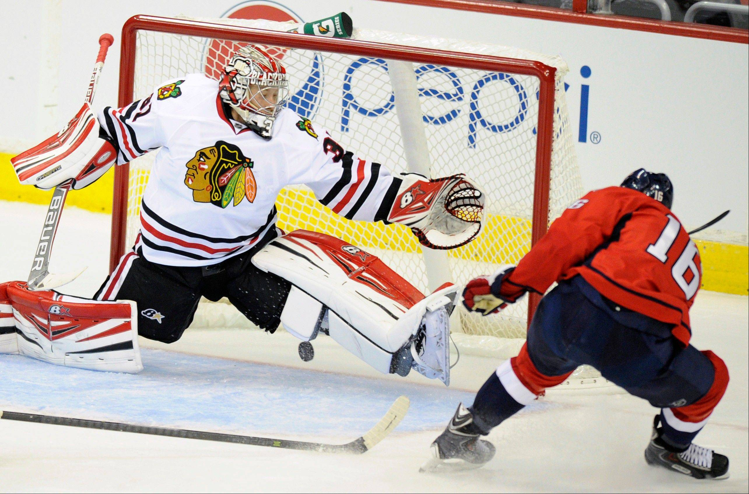 The Capitals� Eric Fehr scores a goal against Blackhawks goalie Antii Raanta during the second period of a preseason game Friday in Washington. (AP Photo/Nick Wass)