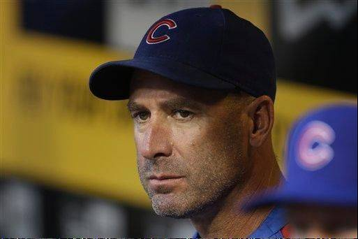 Chicago Cubs manager Dale Sveum (4) stands in the dugout before a baseball game against the Pittsburgh Pirates in Pittsburgh Thursday, Sept. 12, 2013. (AP Photo/Gene J. Puskar)