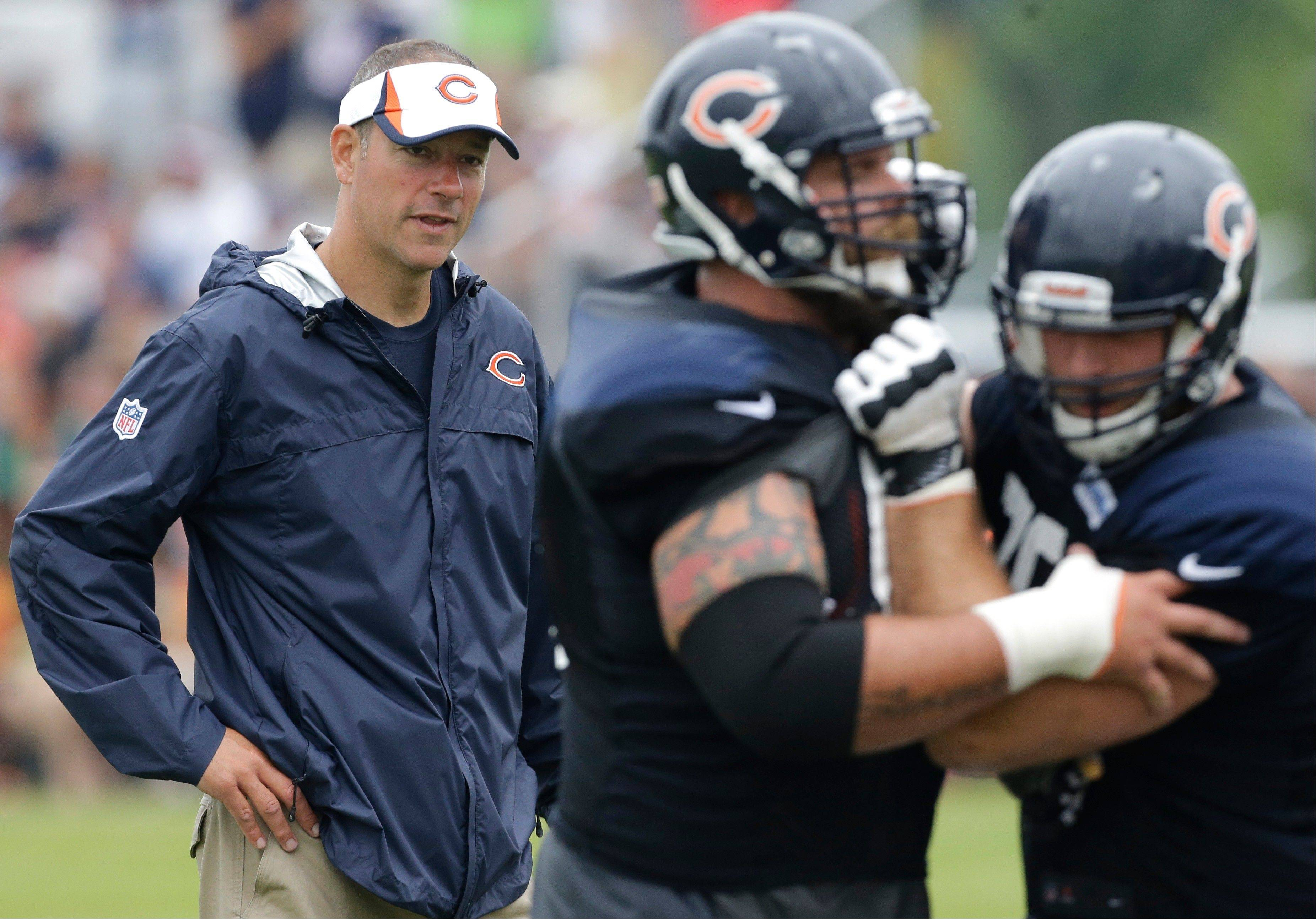 When it comes to which running plays are called on game day, head coach Marc Trestman gives plenty of responsibility to offensive coordinator Aaron Kromer (above).