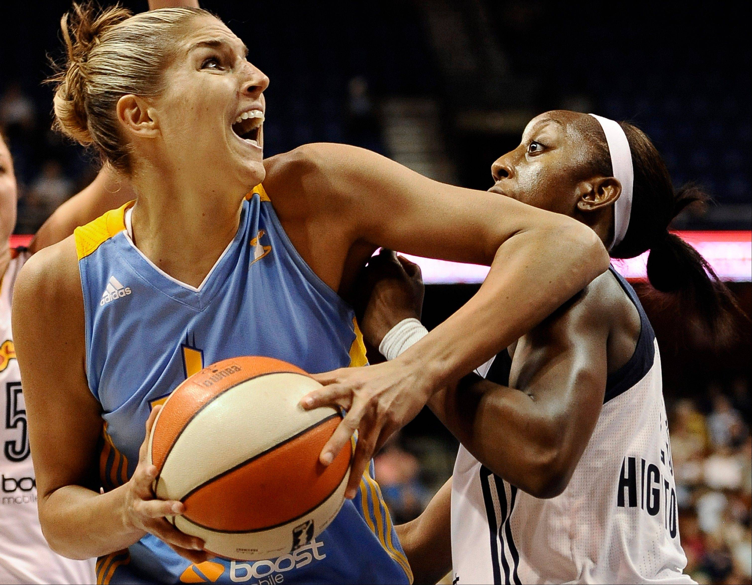 FILE - In this Aug. 9, 2013, file photo, Chicago Sky's Elena Delle Donne, left, is guarded by Connecticut Sun's Allison Hightower during the first half of a WNBA basketball game in Uncasville, Conn. Delle Donne led Chicago to its first postseason berth in franchise history and hopes to help the Sky defeat defending WNBA champion, Indiana Fever, in the opening round. (AP Photo/Jessica Hill, File)