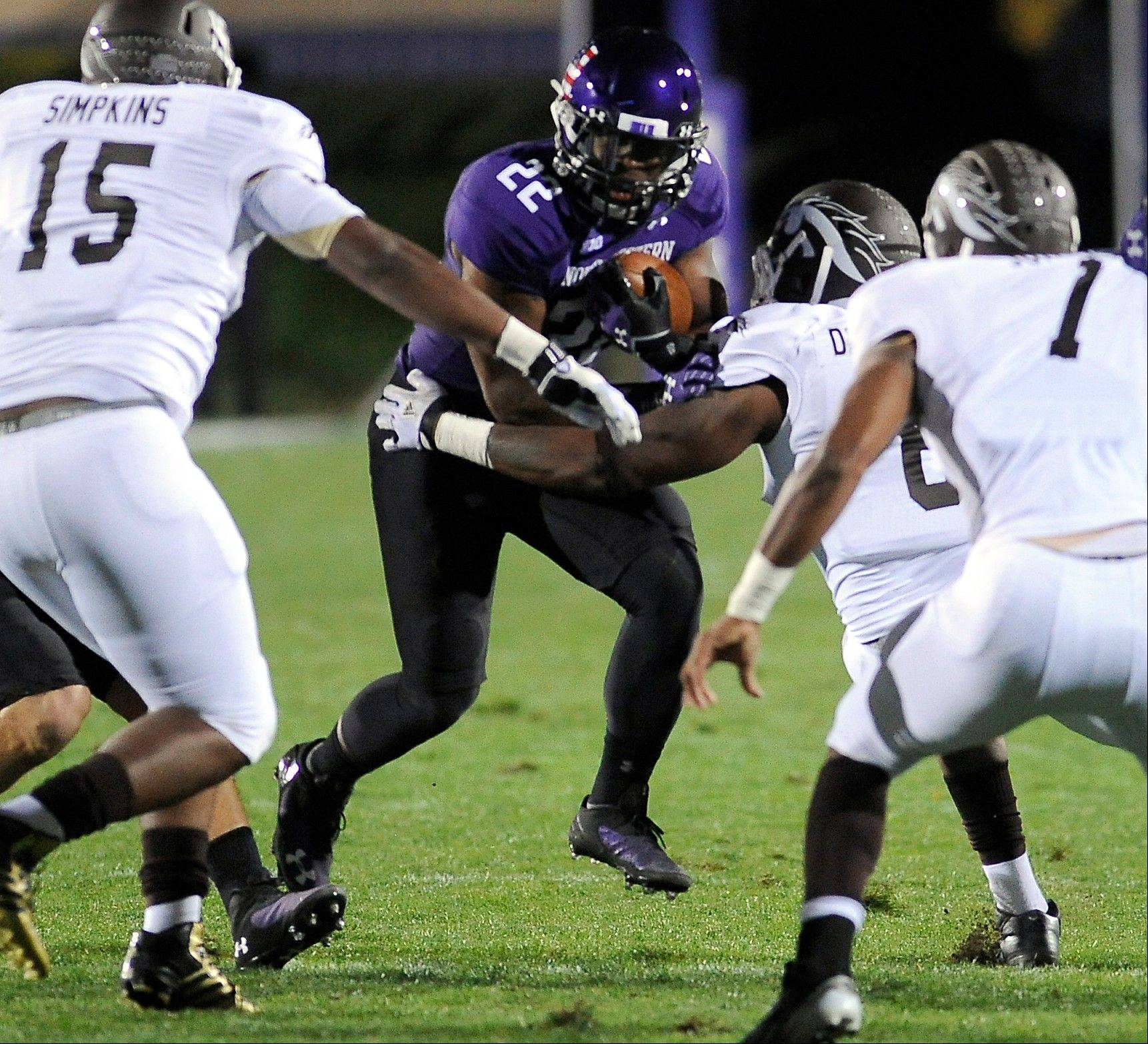 Northwestern�s Treyvon Green runs against Western Michigan during last week�s win in Evanston. He amassed a personal-best 158 yards and two TDs.