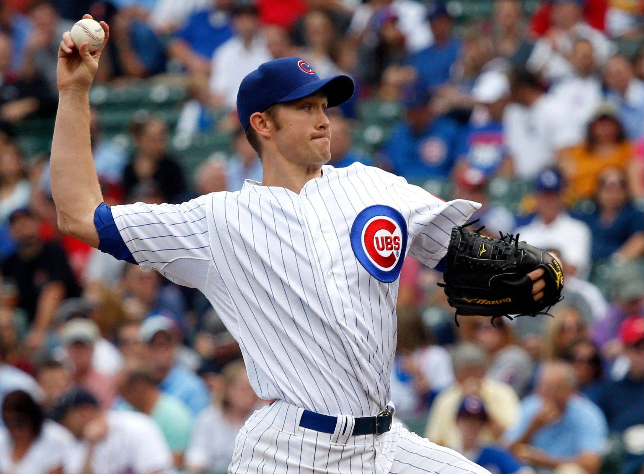 Chicago Cubs starting pitcher Scott Baker delivers during the first inning of a baseball game the Atlanta Braves Friday, Sept. 20, 2013, in Chicago. (AP Photo/Charles Rex Arbogast)