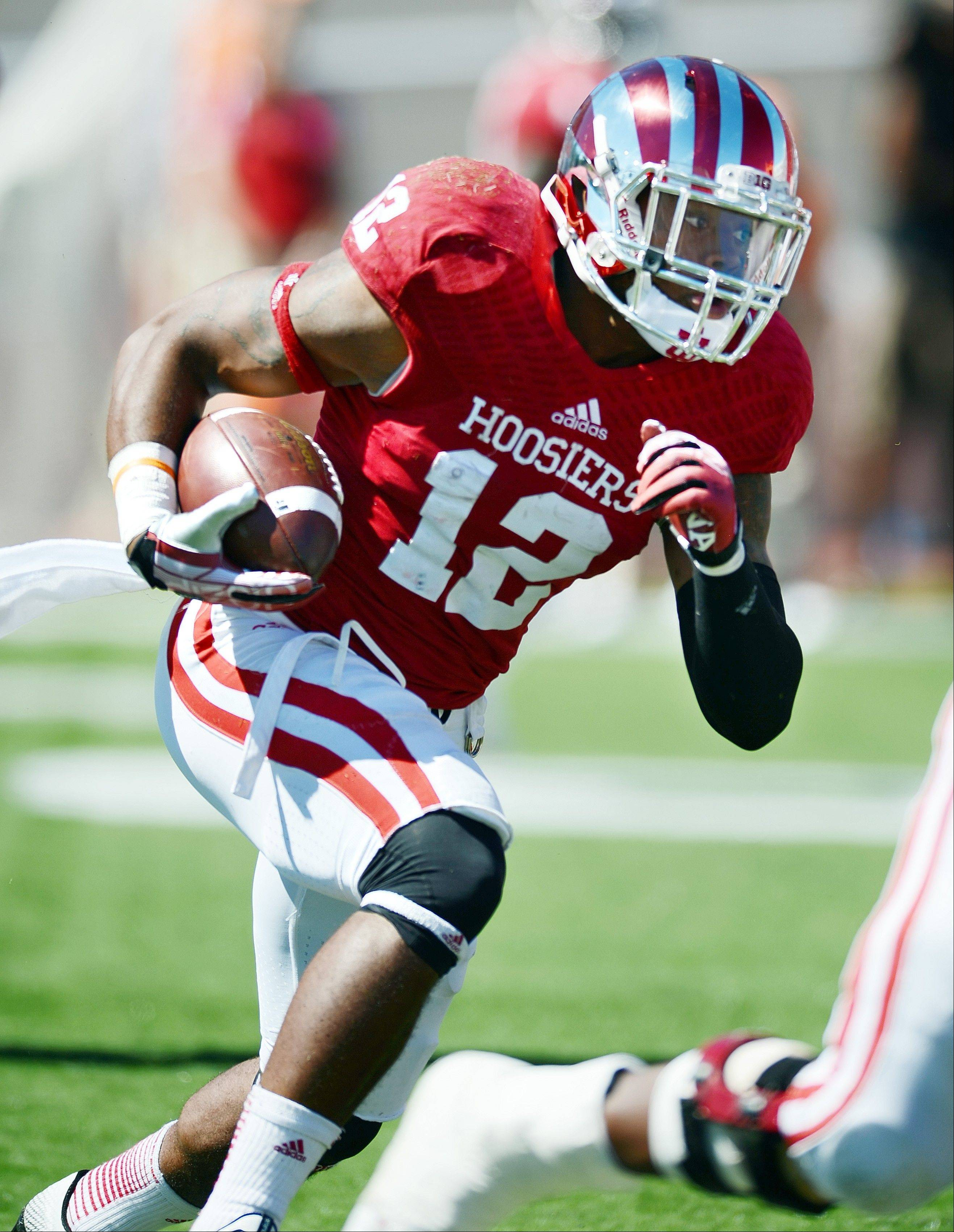 Indiana�s Stephen Houston runs against Bowling Green during last weekend�s game in Bloomington, Ind. The Hoosiers average 50.0 points per game.
