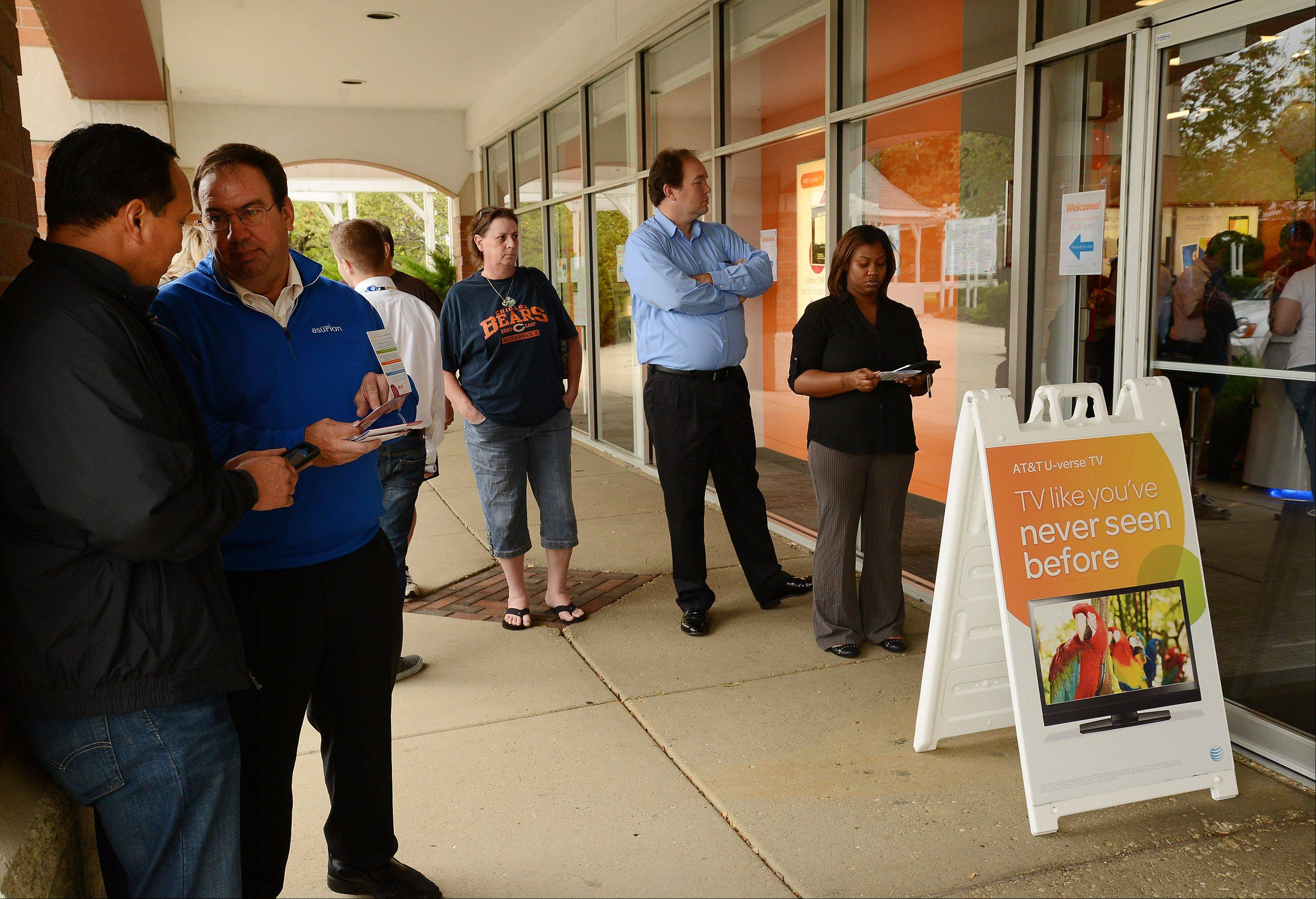 People line up outside to purchase the new iPhone 5S at the ATT store in Schaumburg.
