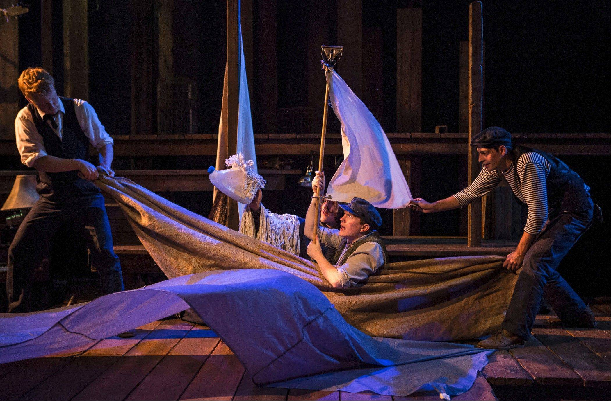 "courtesy of Liz LaurenThe Old Man (Ryan Melia), center, and his canine companion sail to the end of the world to find the man's wife in PigPen Theatre Company's inventive ""The Old Man and the Old Moon,"" running through November at Writers Theatre in Glencoe."