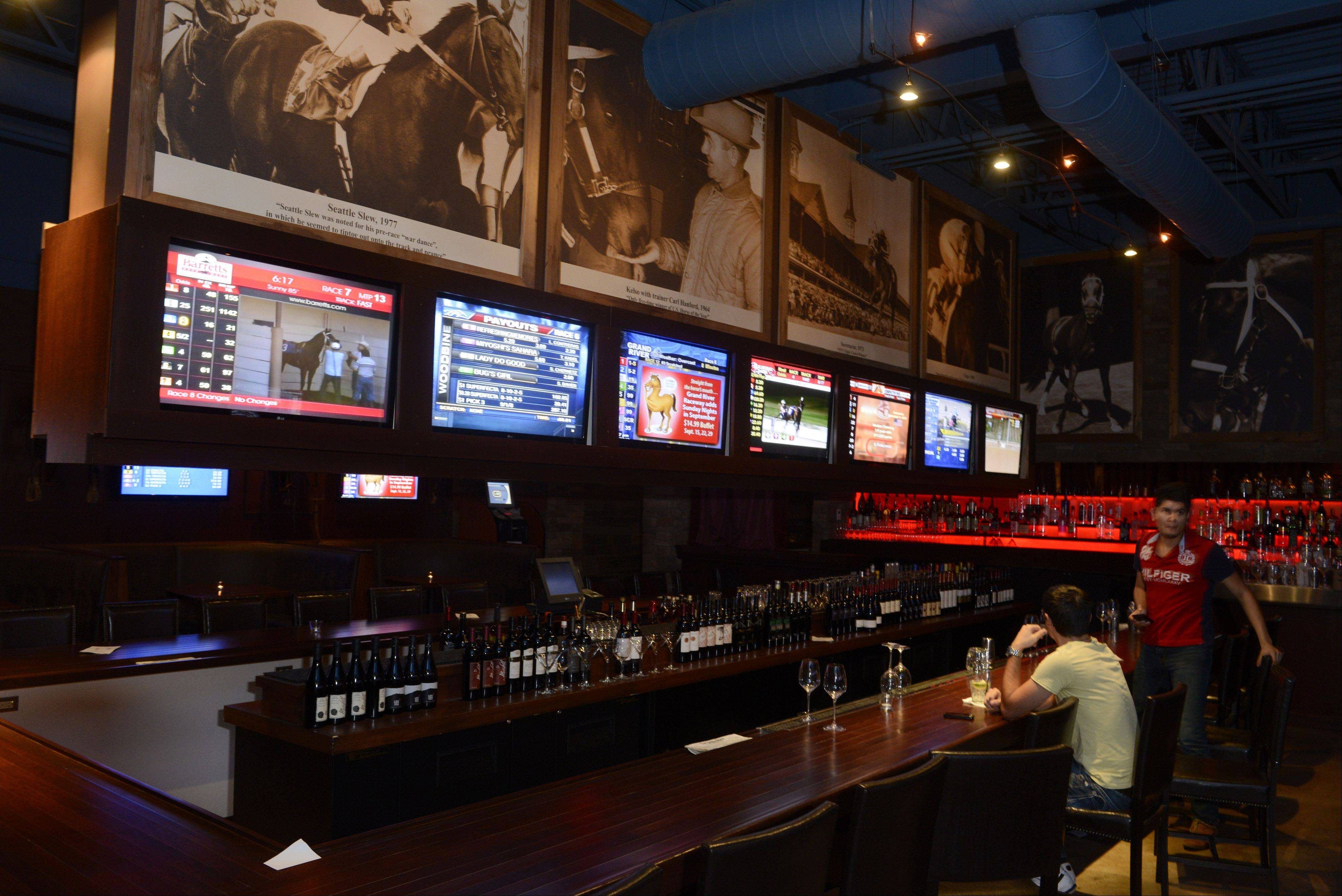 You can watch horse racing and place bets at The Saddle Room in Hoffman Estates.