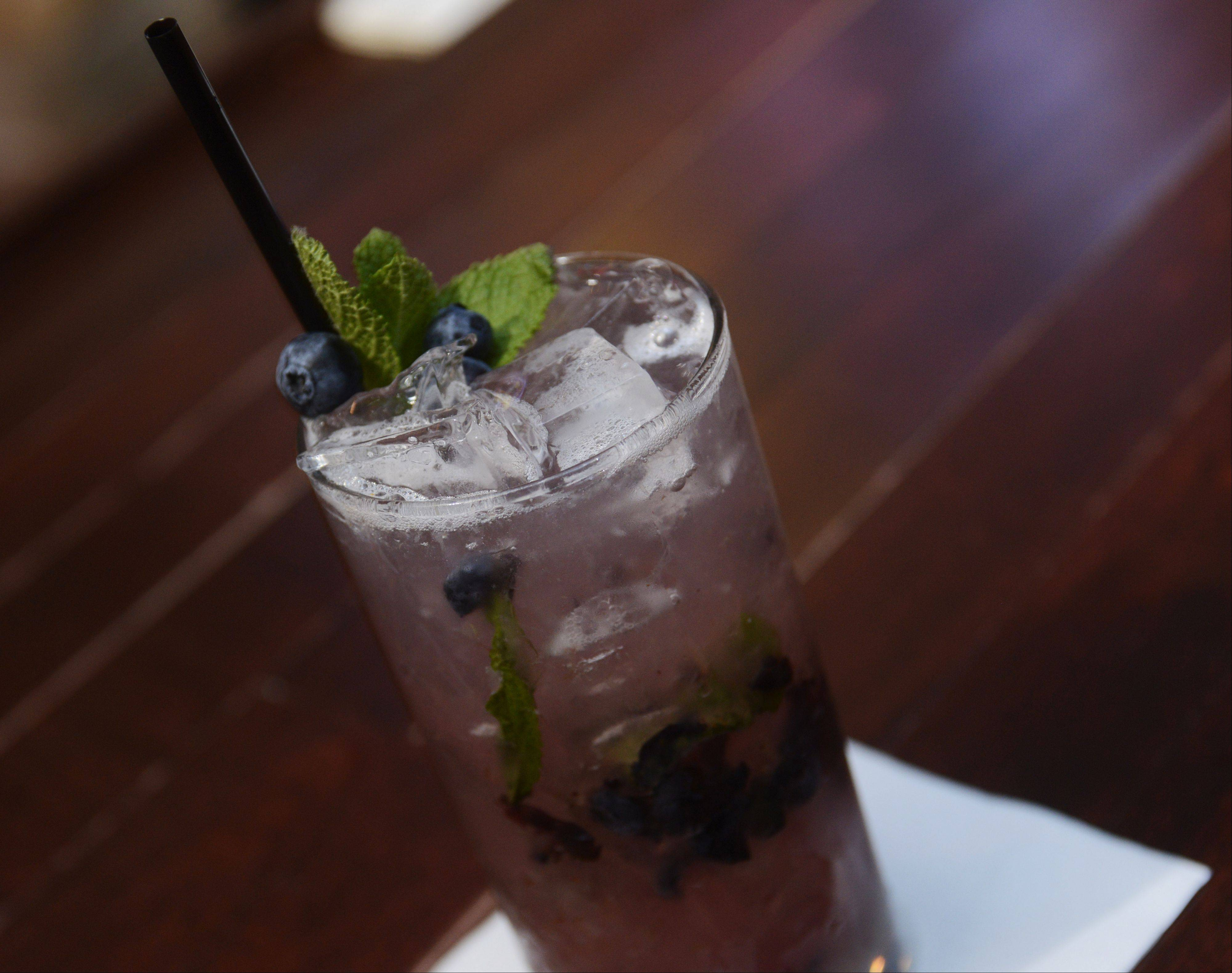 The Saddle Room's blueberry mojito features muddled mint and fresh berries.
