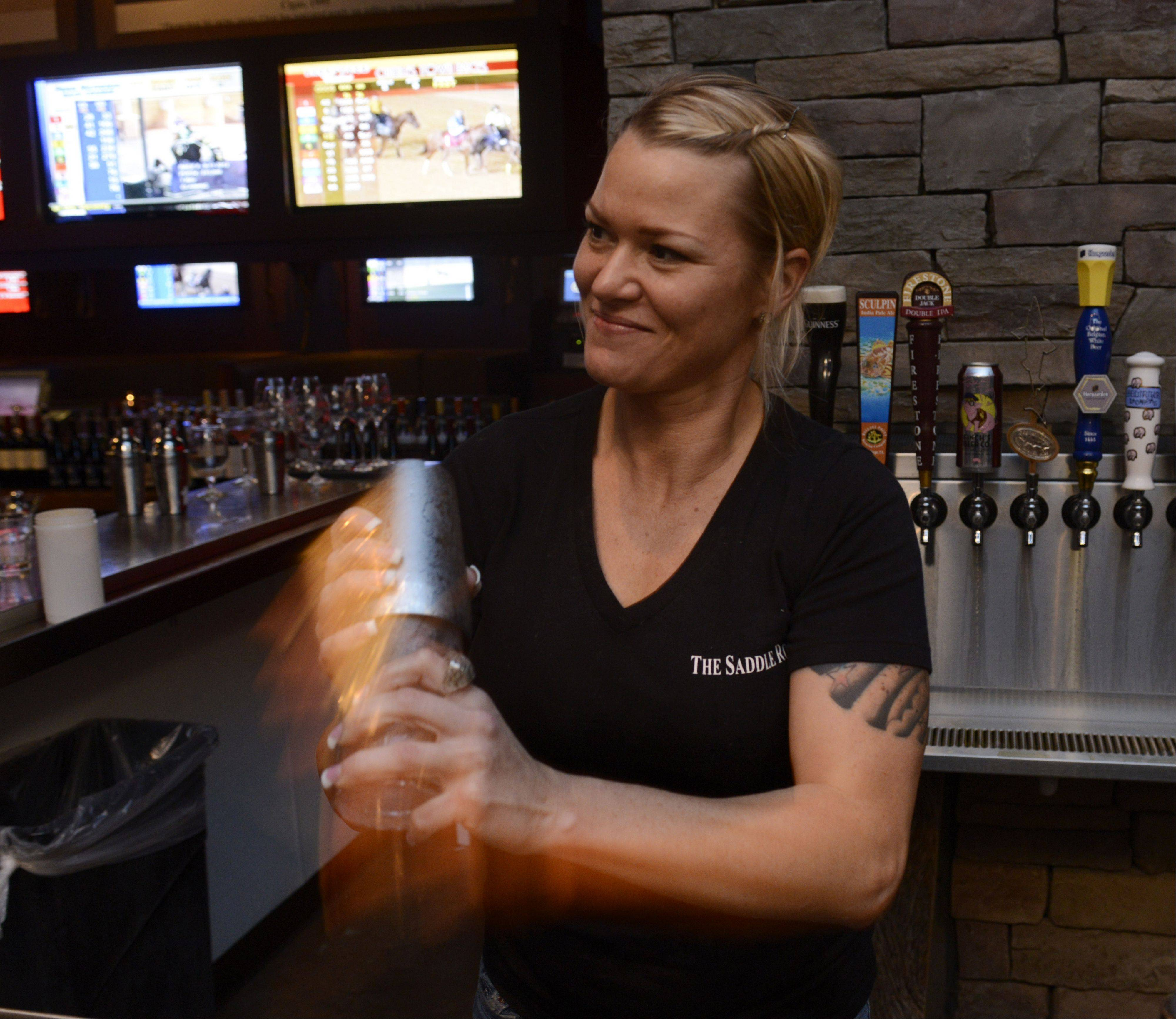 Bartender Maria Kuc prepares a drink at The Saddle Room in Hoffman Estates.