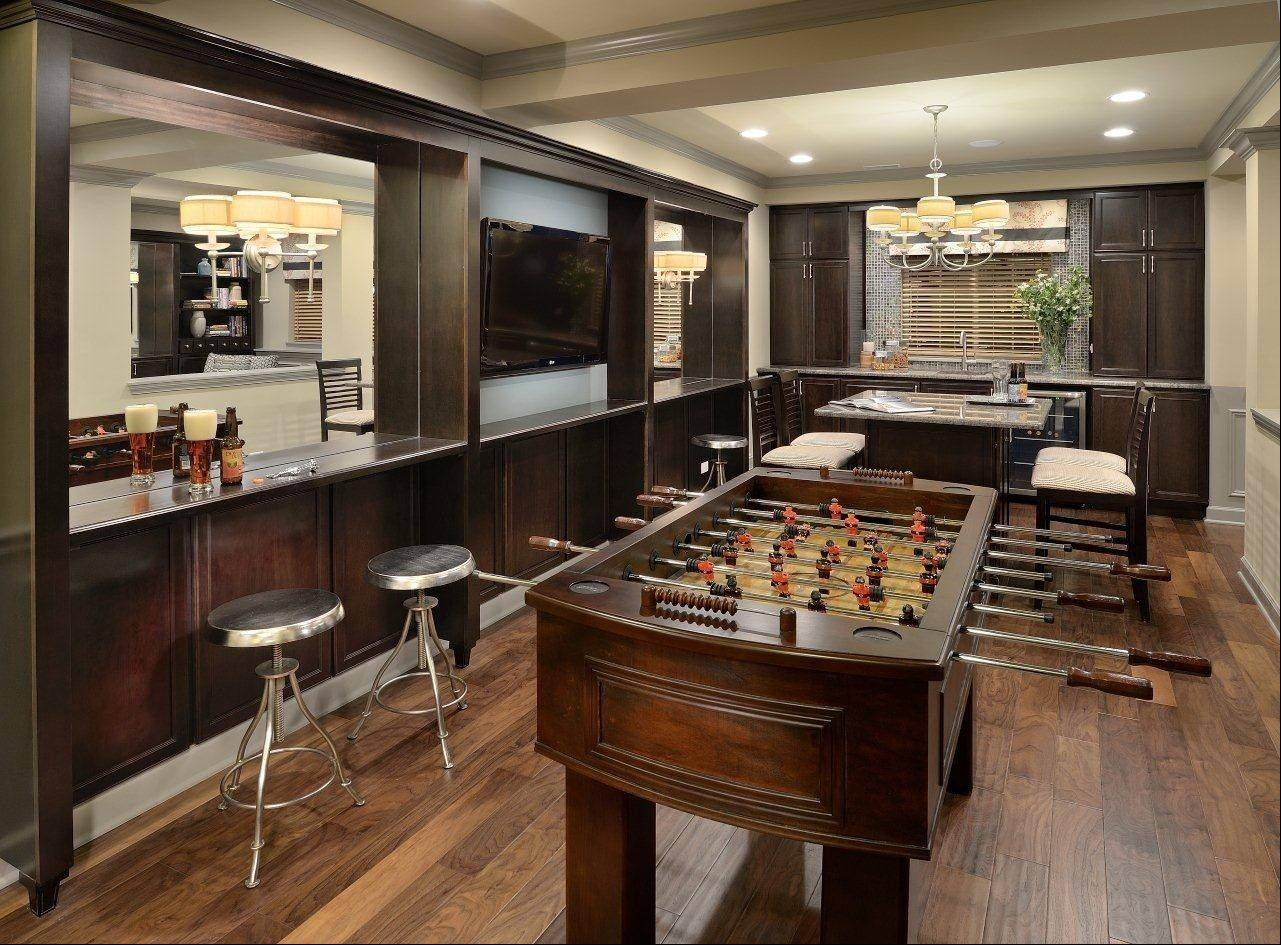 This game room and finished basement is found in the Braeden townhouse model at The Orchards in Lombard.