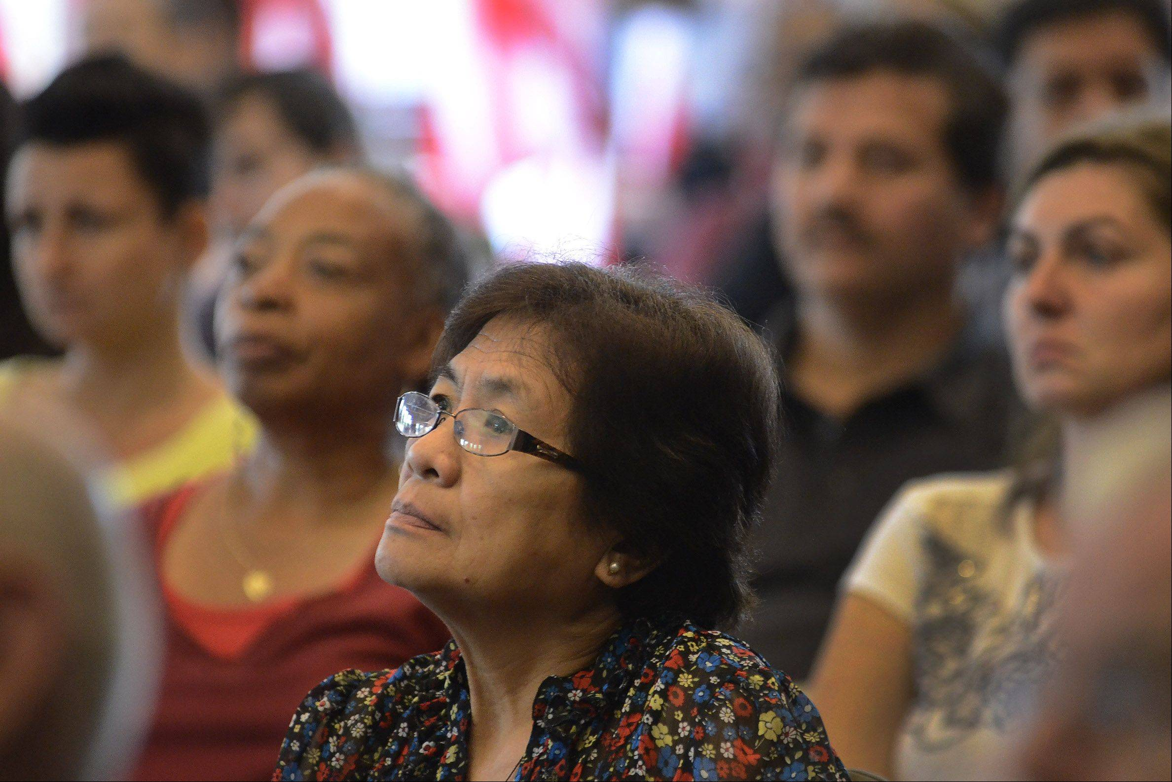 More than 70 individuals received their citizenship at a naturalization ceremony at the Schaumburg Township District Library Friday.