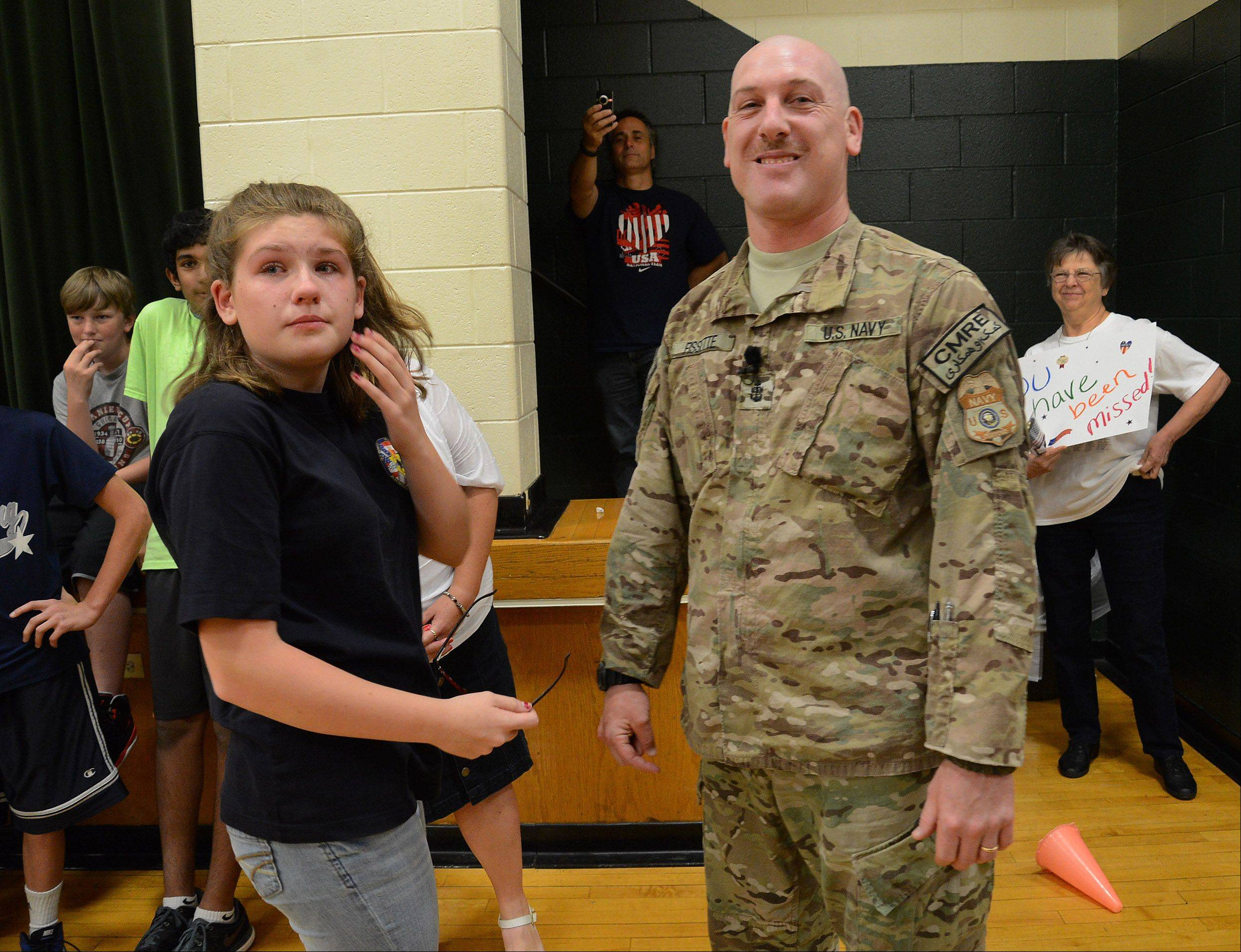 Navy Chief Gunner's Mate Patrick Fissette is all smiles after surprising his daughter, Kailey, at Mead Junior High School in Elk Grove Village Friday after returning home from his last tour of duty.