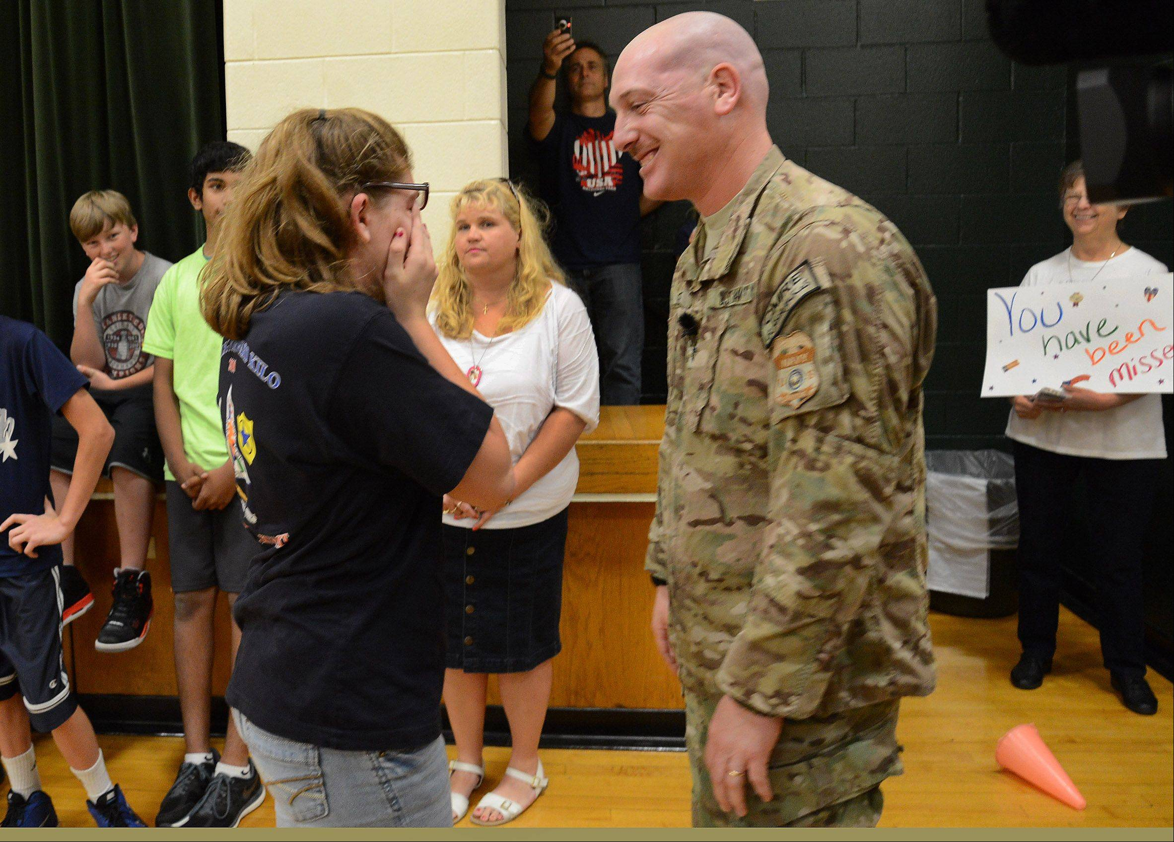 Navy Chief Gunner's Mate Patrick Fissette surprises his daughter, Kailey, at Mead Junior High School in Elk Grove Village Friday after returning from his last overseas tour of duty.