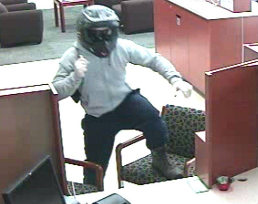 Security photo from Associated Bank in Third Lake shows the robbery suspect who jumped onto the teller's counter on Thursday, Sept. 19, at approximately 10:47 a.m. and demanded money to be placed into a black Puma drawstring backpack.