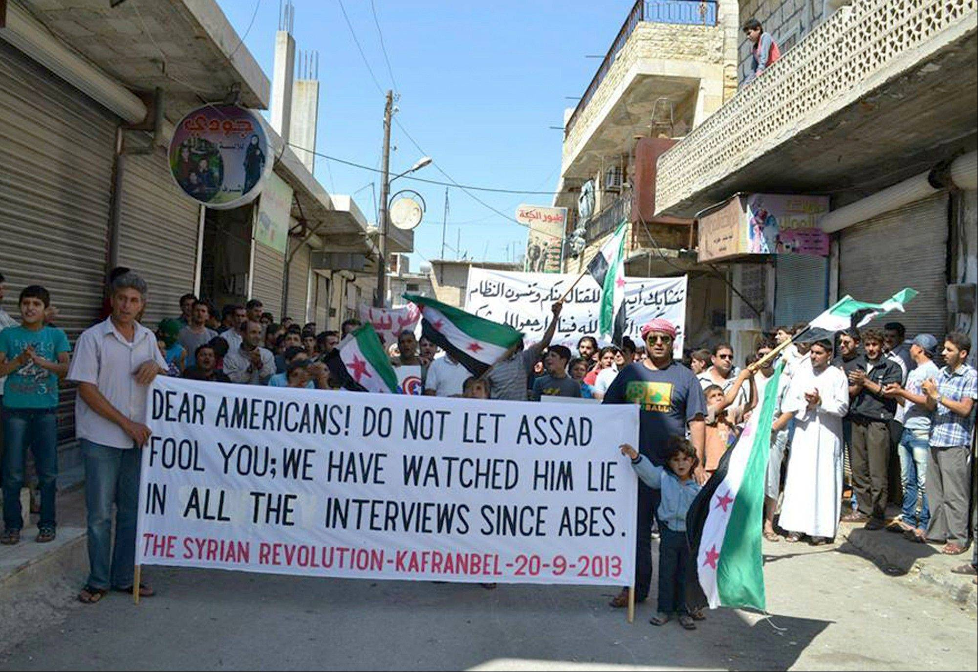 Anti-Syrian regime protesters demonstrate in northern Syria, Friday, Sept. 20, 2013. Syria's main Western-backed opposition group on Friday slammed al-Qaida-linked gunmen and their expanding influence in the country, saying the jihadis' push to establish an Islamic state undermines the rebels' struggle for a free Syria.