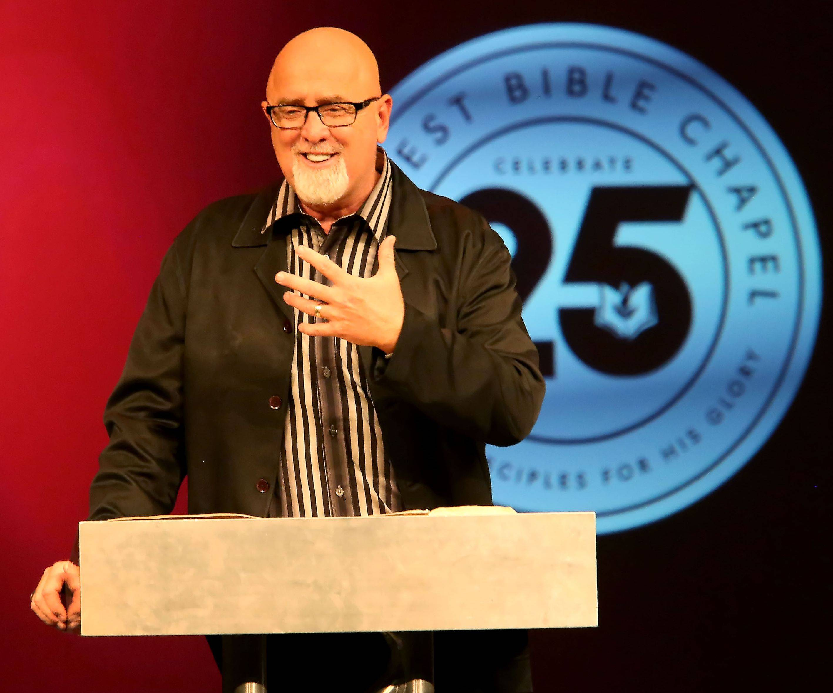 Pastor James MacDonald at the Elgin pulpit. MacDonald speaks from a different Harvest Bible house of worship each week, while his message is beamed to the other churches.