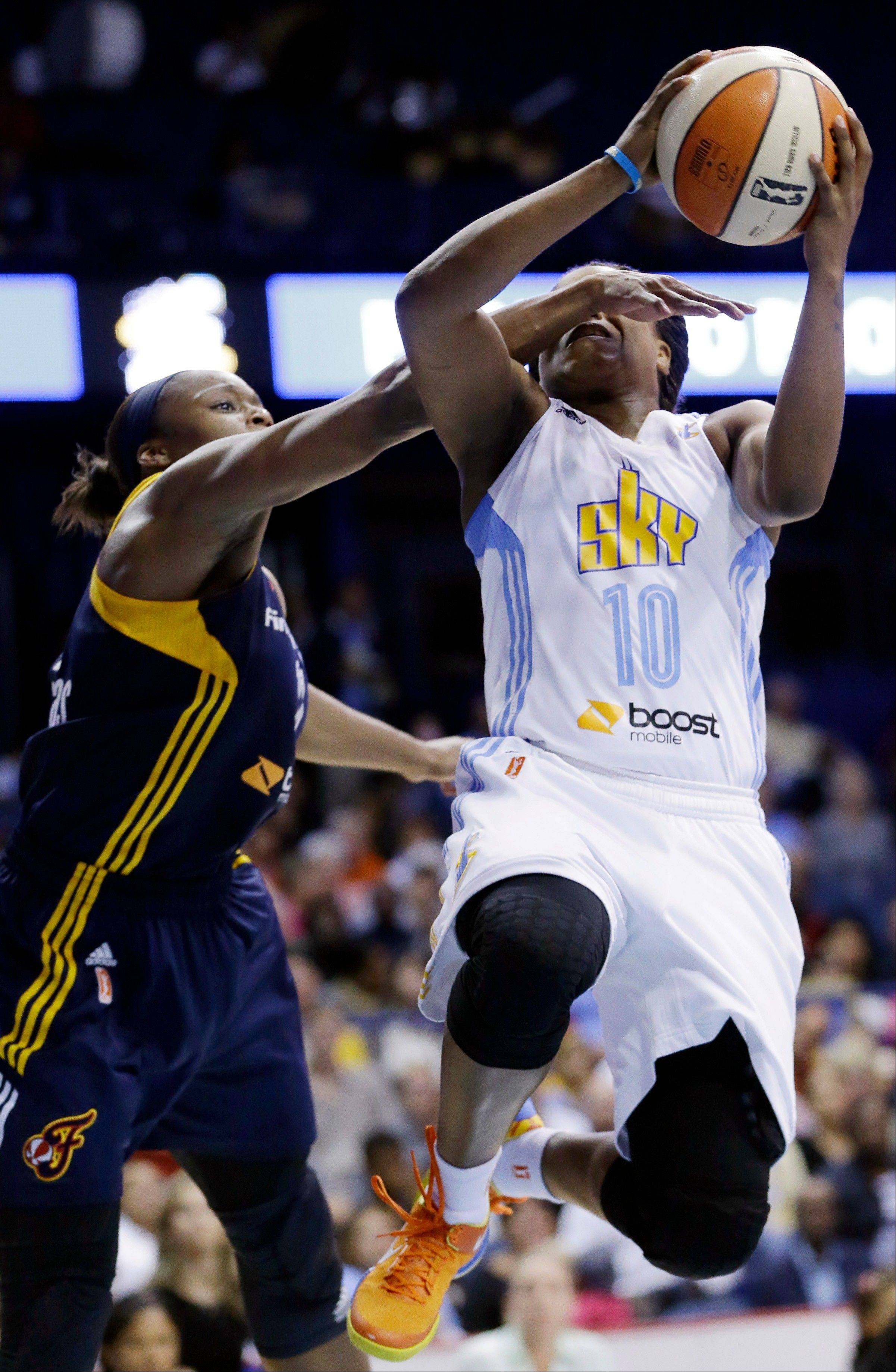 Indiana Fever forward Karima Christmas, left, fouls Chicago Sky guard Epiphanny Prince during the second half in Game 1 of the WNBA basketball Eastern Conference semifinal series on Friday, Sept. 20, 2013, in Rosemont, Ill. The Fever won 85-72.
