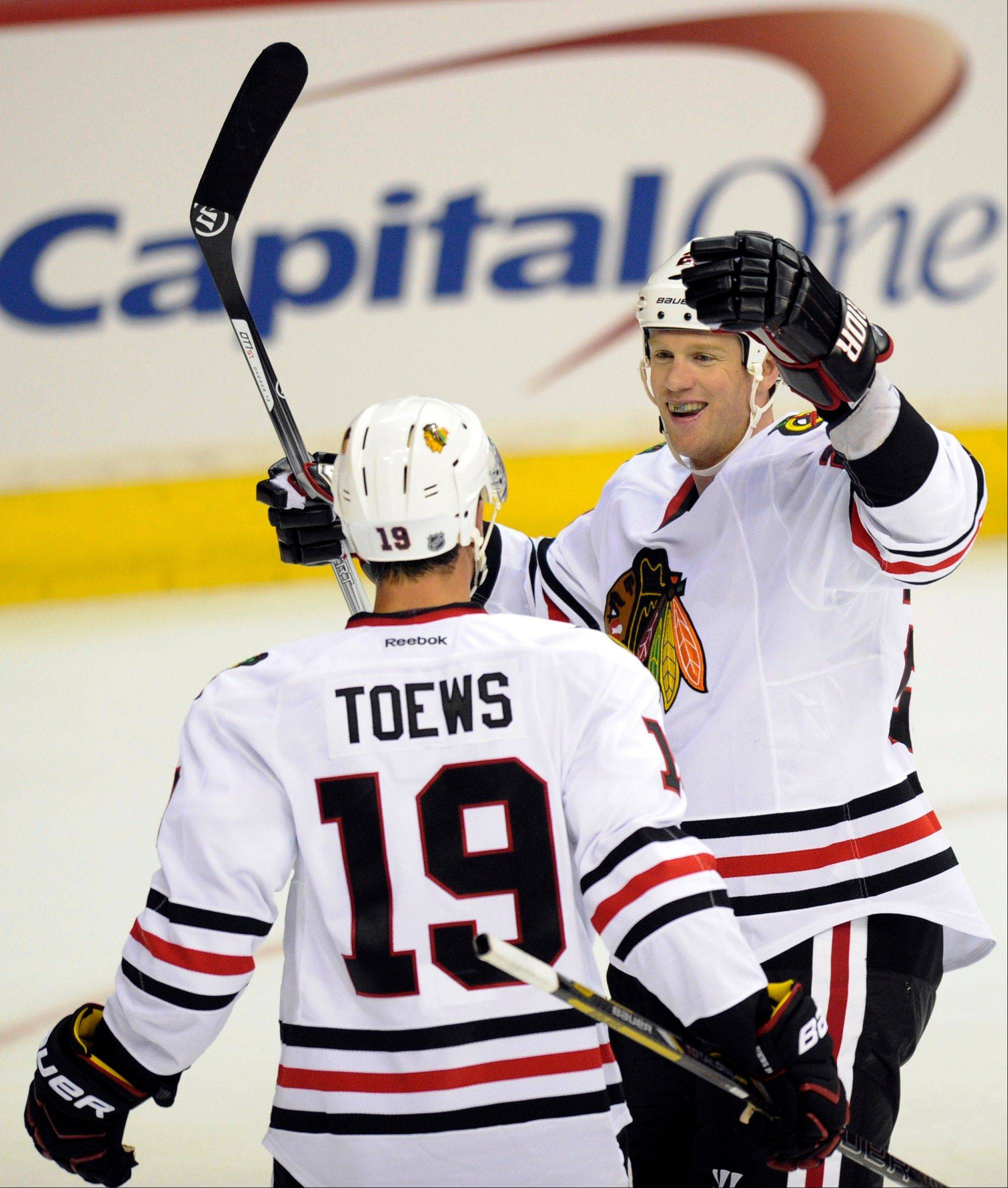 The Blackhawks' Brad Winchester celebrates his goal with Jonathan Toews against the Capitals on Friday.