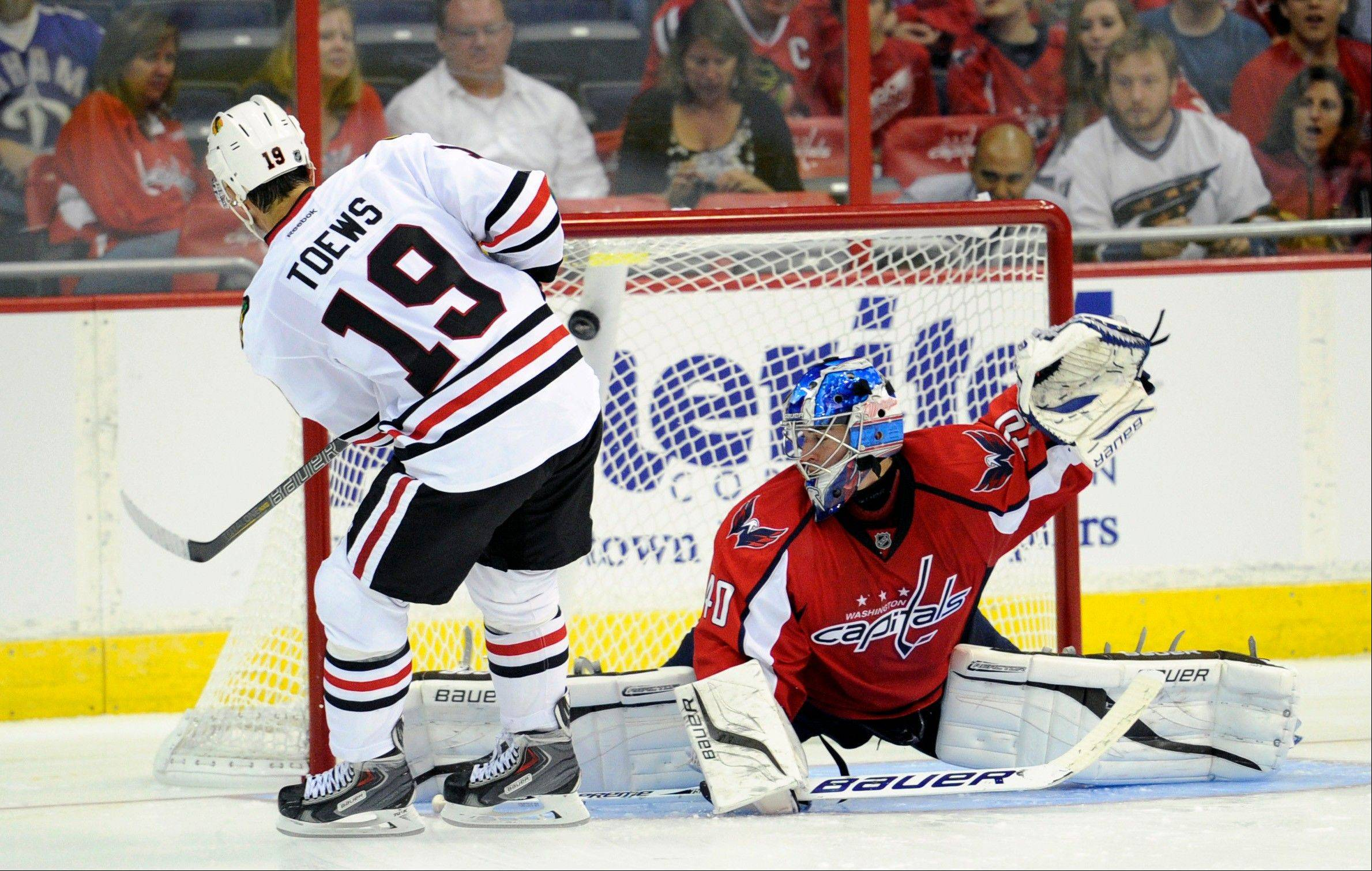 Jonathan Toews scores the only a goal during a shootout Friday that gave the Hawks a 5-4 preseason victory over the Capitals in Washington.