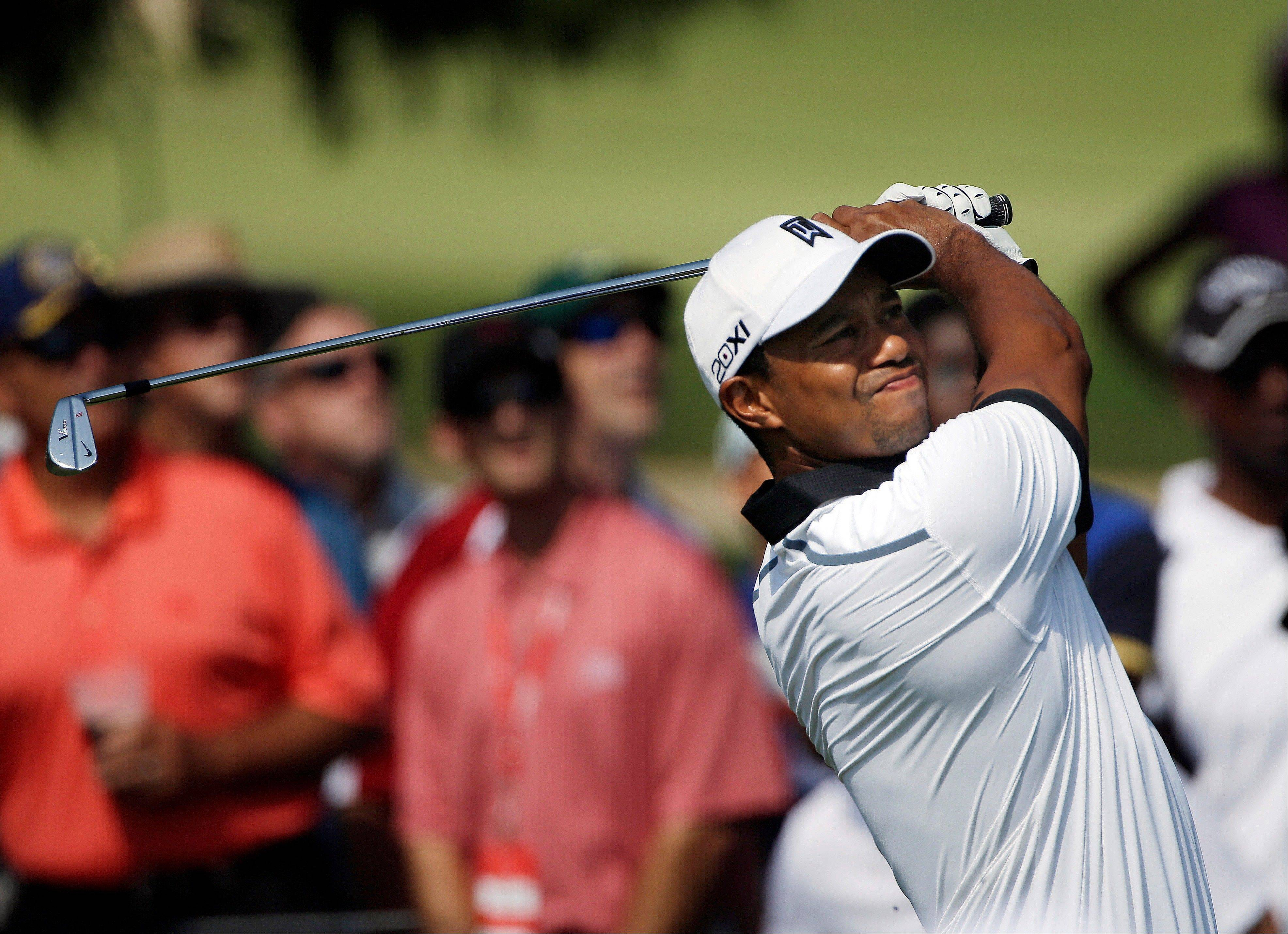 Tiger Woods hits from the second tee during the second round of the Tour Championship golf tournament Friday at East Lake Golf Club in Atlanta.
