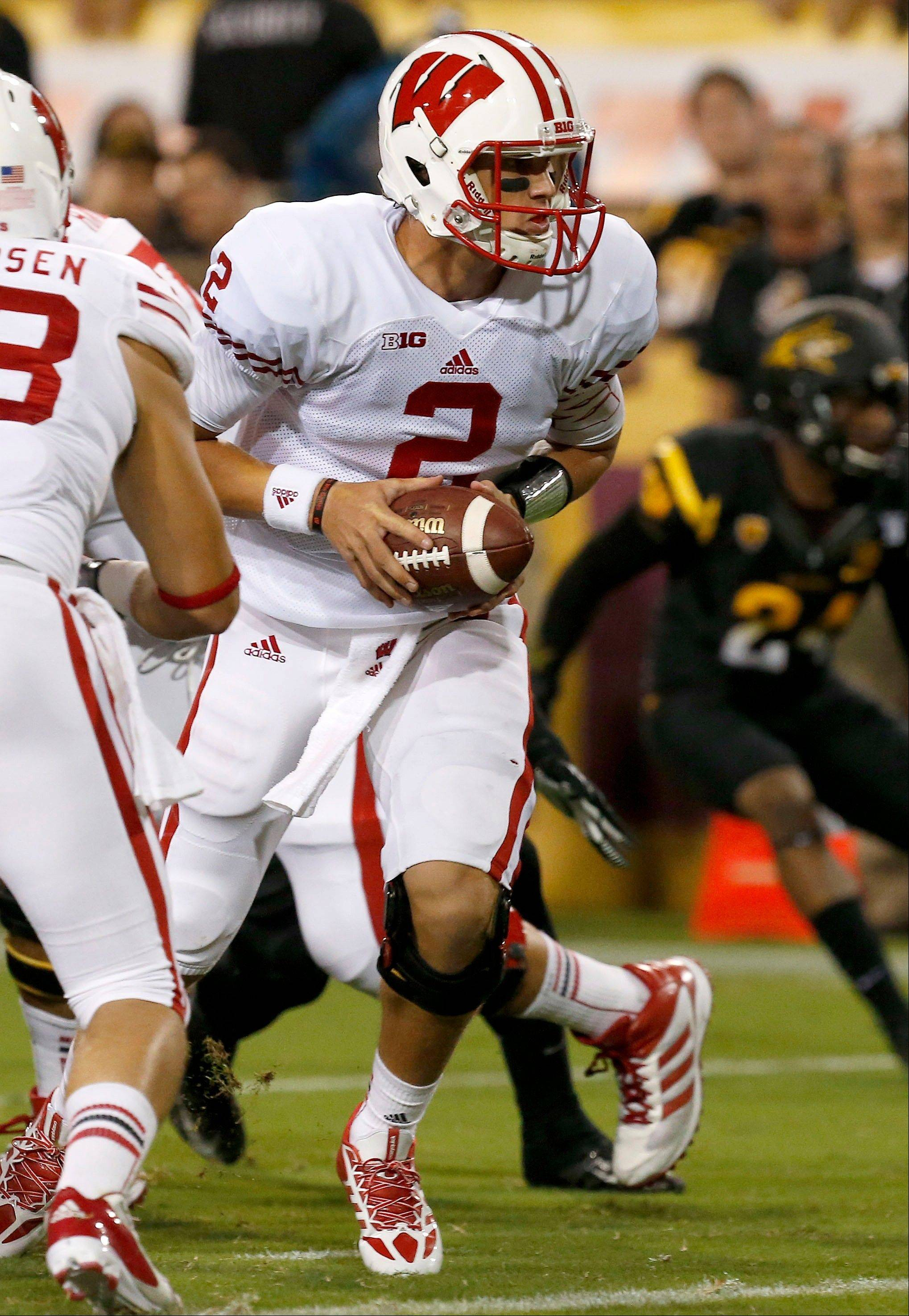 Wisconsin's Joel Stave looks to hand off the ball in the first half last Saturday's road game against Arizona State.