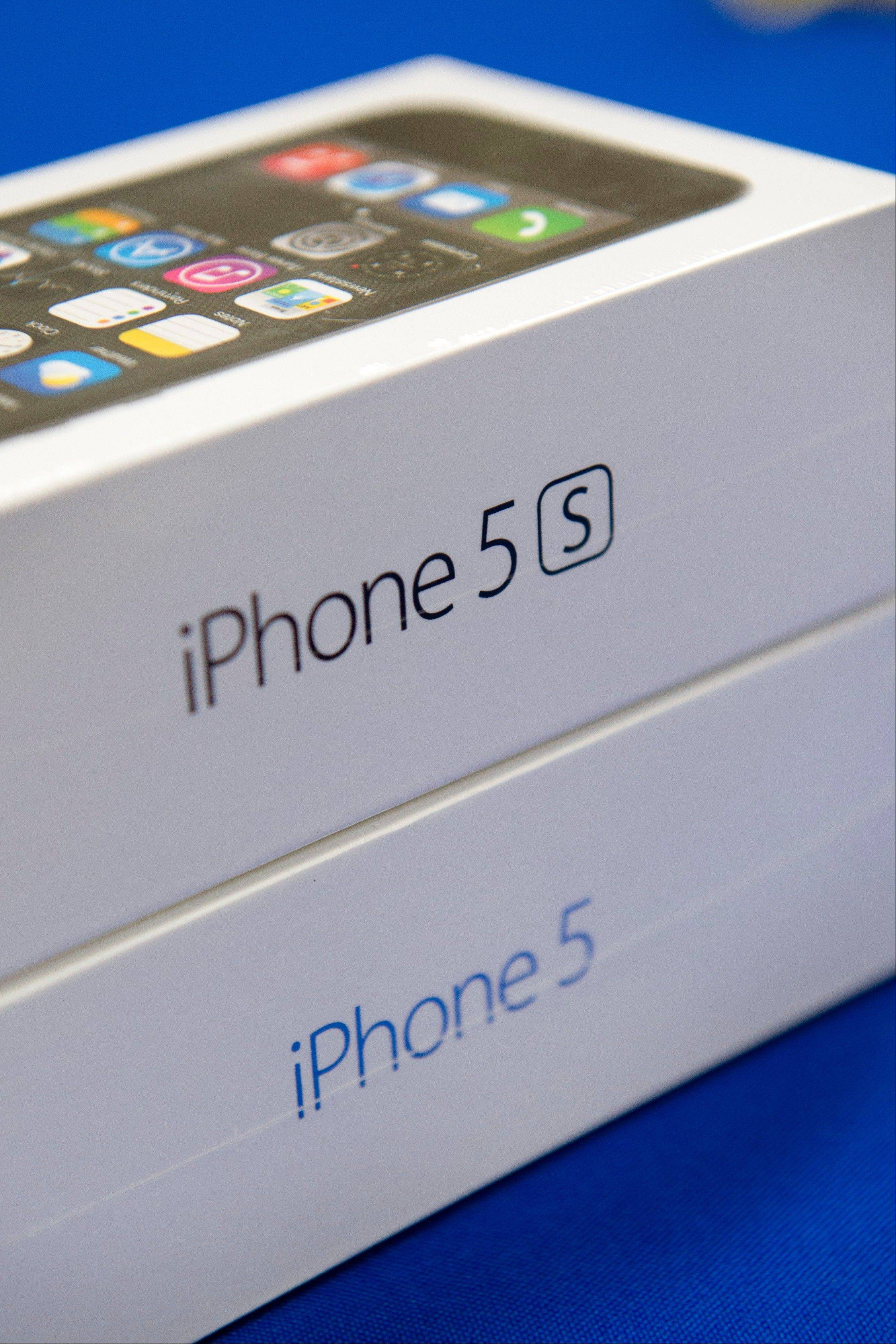 The new iPhone 5s sits atop the model that precedes it on Friday, the day of its release, at a Best Buy in Atlanta, Friday.