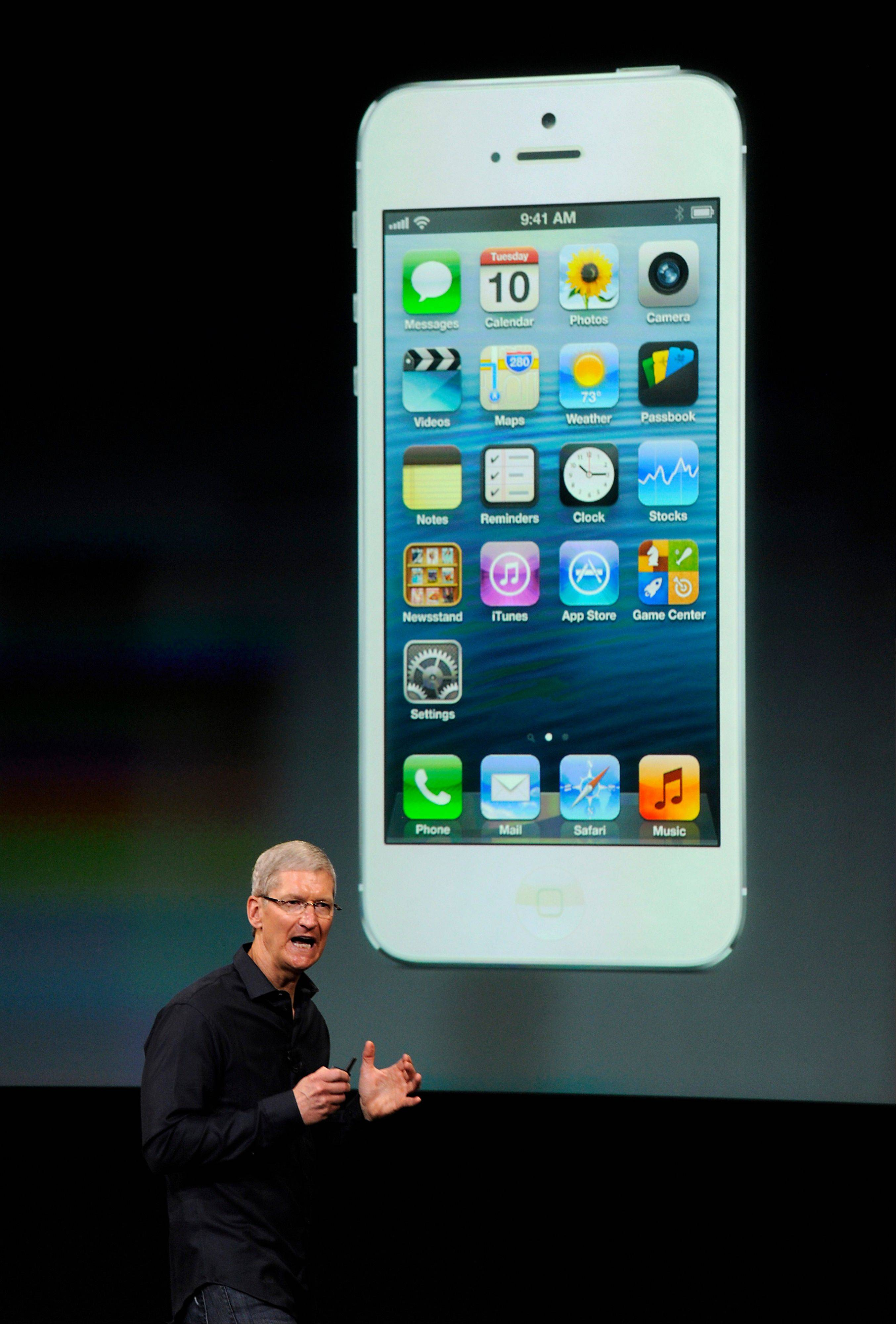 Tim Cook, chief executive officer of Apple Inc., speaks during a product announcement in California, on Tuesday, Sept. 10, 2013. Apple Inc. announced two new iPhones including one with lower prices and more color options, in a strategy shift by Cook to reach a broader range of customers around the world.