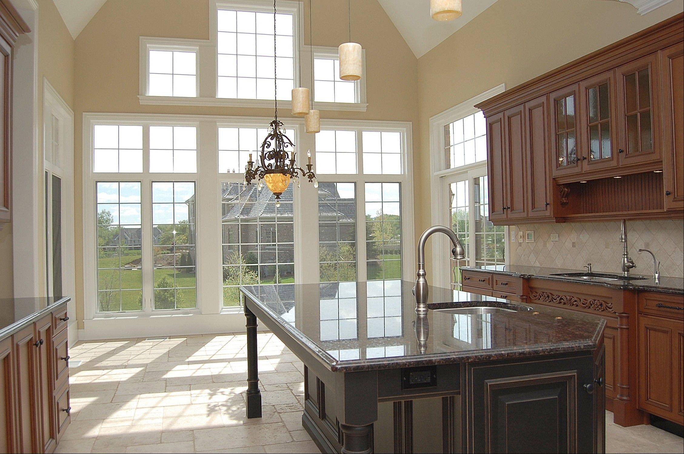 The kitchen features a wall of windows to create a bright, light environment.