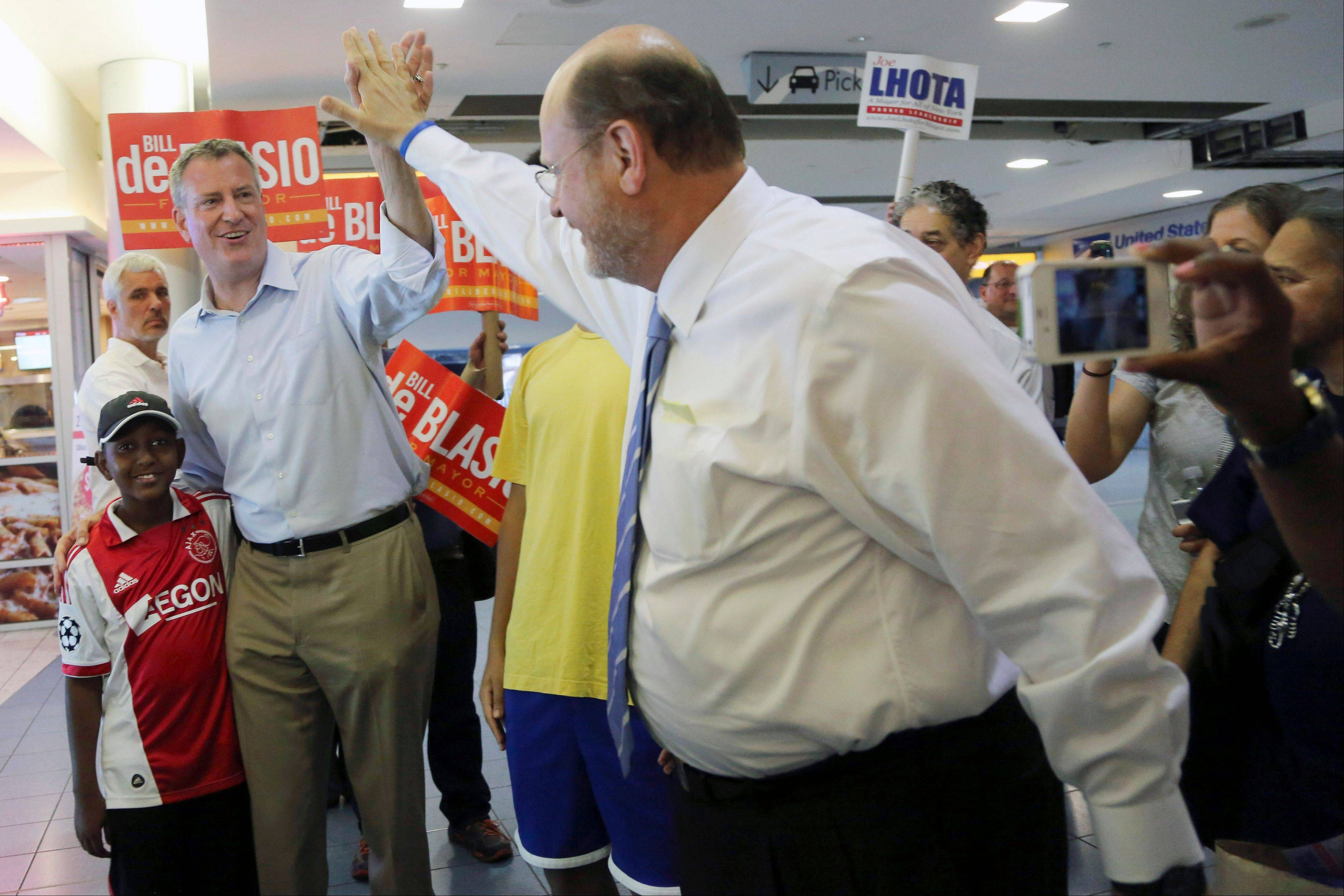 FILE- In this Sept. 4, 2013, file photo, Republican mayoral candidate Joe Lhota, right, greets Democratic mayoral hopeful Bill de Blasio at the Staten Island ferry terminal in New York. Lhota, the Republican nominee for mayor, faces long odds, down 40 points in the polls to de Blasio. One pundit says Lhota has little chance to win �unless there�s a disaster.� (AP Photo/Mary Altaffer, File)