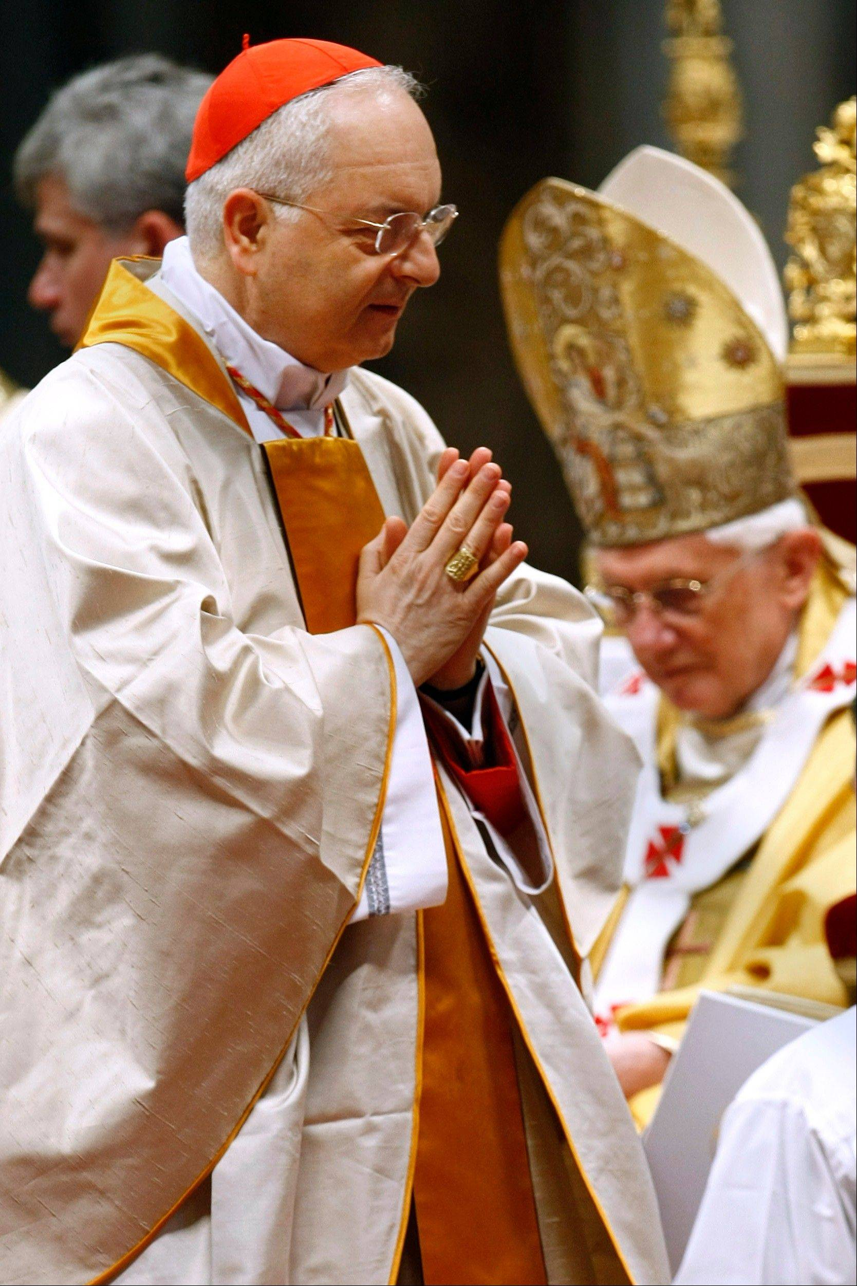 Associated Press/File photo/Nov. 21, 2010 Cardinal Mauro Piacenza walks past Pope Benedict XVI after receiving Cardinal�s ring during a Mass in St. Peter�s Basilica, at the Vatican. Pope Francis on Saturday effectively demoted a highly conservative Italian cardinal who led the Vatican�s department on clergy, while keeping in place a German prelate who wages the Catholic church�s crackdown on liberal U.S. nuns and helps craft its sex-abuse response. Francis removed Cardinal Mauro Piacenza, with a reputation for being highly traditional on matters of liturgy and the question of priestly celibacy, from the important post of prefect of the congregation for clergy. Piacenza had only held that post since 2010, when he was appointed by Francis� predecessor, Benedict XVI, whose retro tastes in papal vestments and preference for traditional ceremonies found a supporter in the Italian prelate.