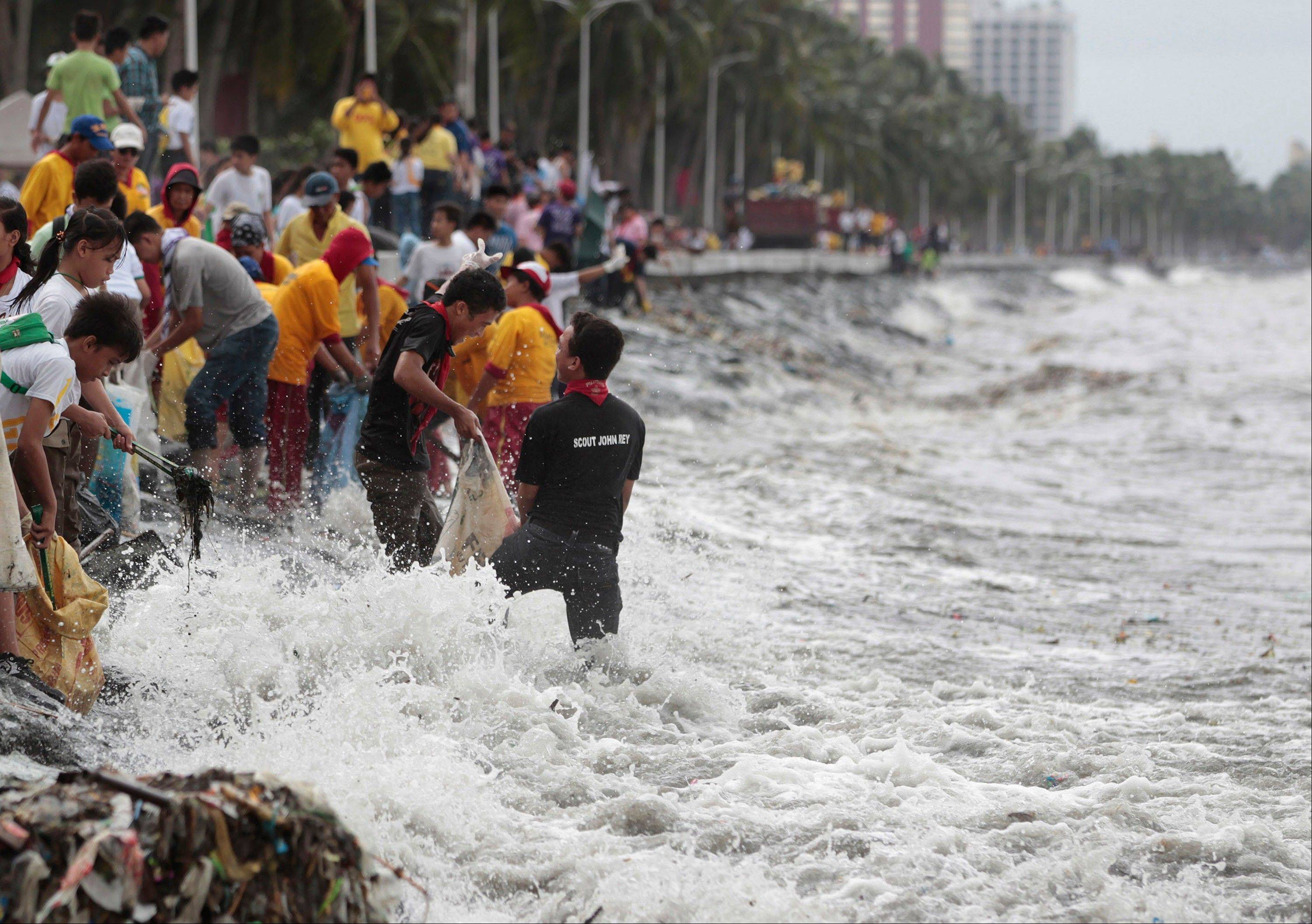 Strong waves hit students and volunteers joining the international coastal cleanup day at the polluted Manila bay, Philippines on Saturday Sept. 21. Usagi, the most powerful typhoon of the year swept through the Luzon Strait separating the Philippines and Taiwan on Saturday, battering island communities and dumping rain as it eyed landfall in Hong Kong.
