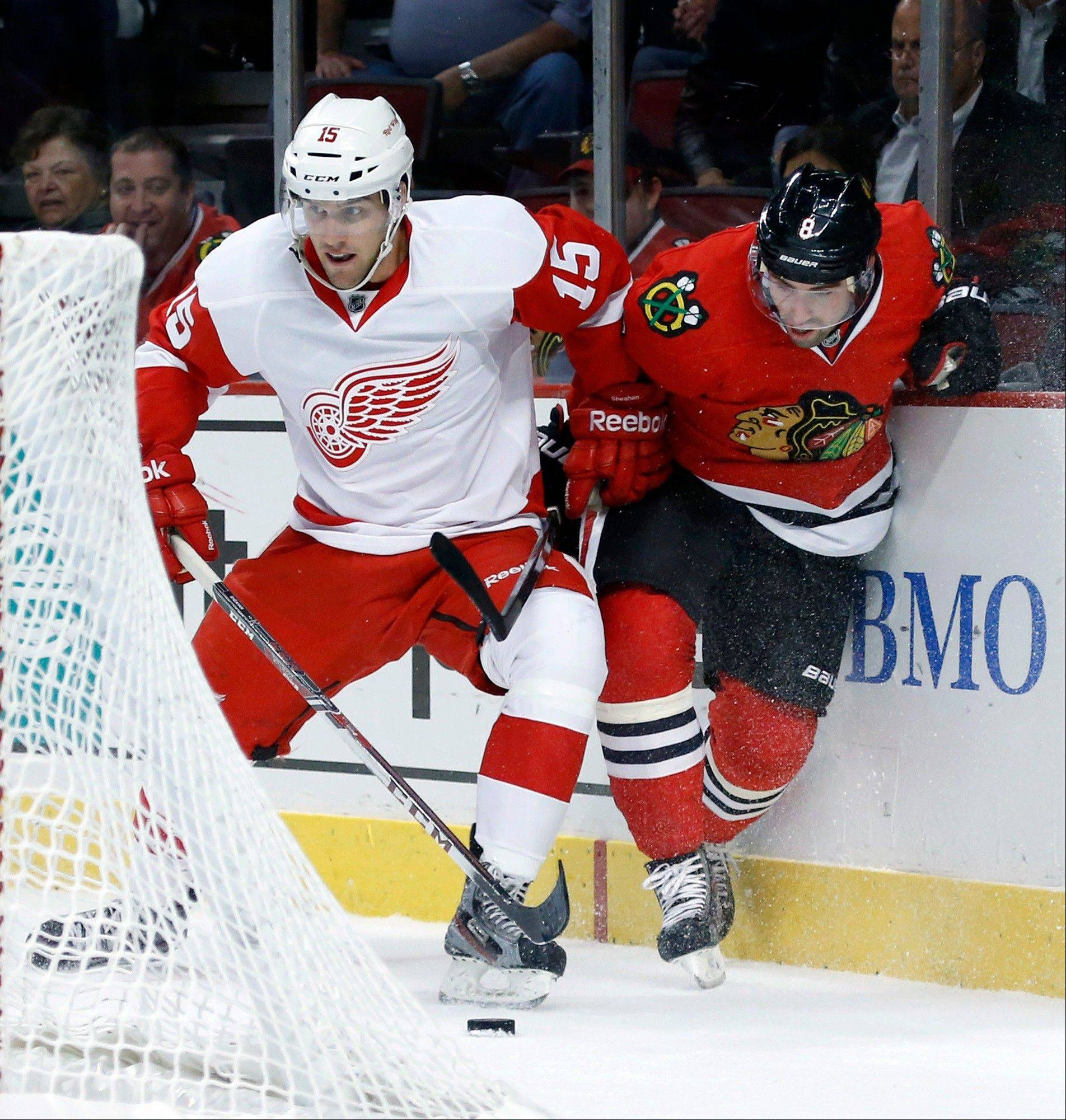 Blackhawks defenseman Nick Leddy, right, battles Red Wings center Riley Sheahan for the puck during the preseason opener last week.