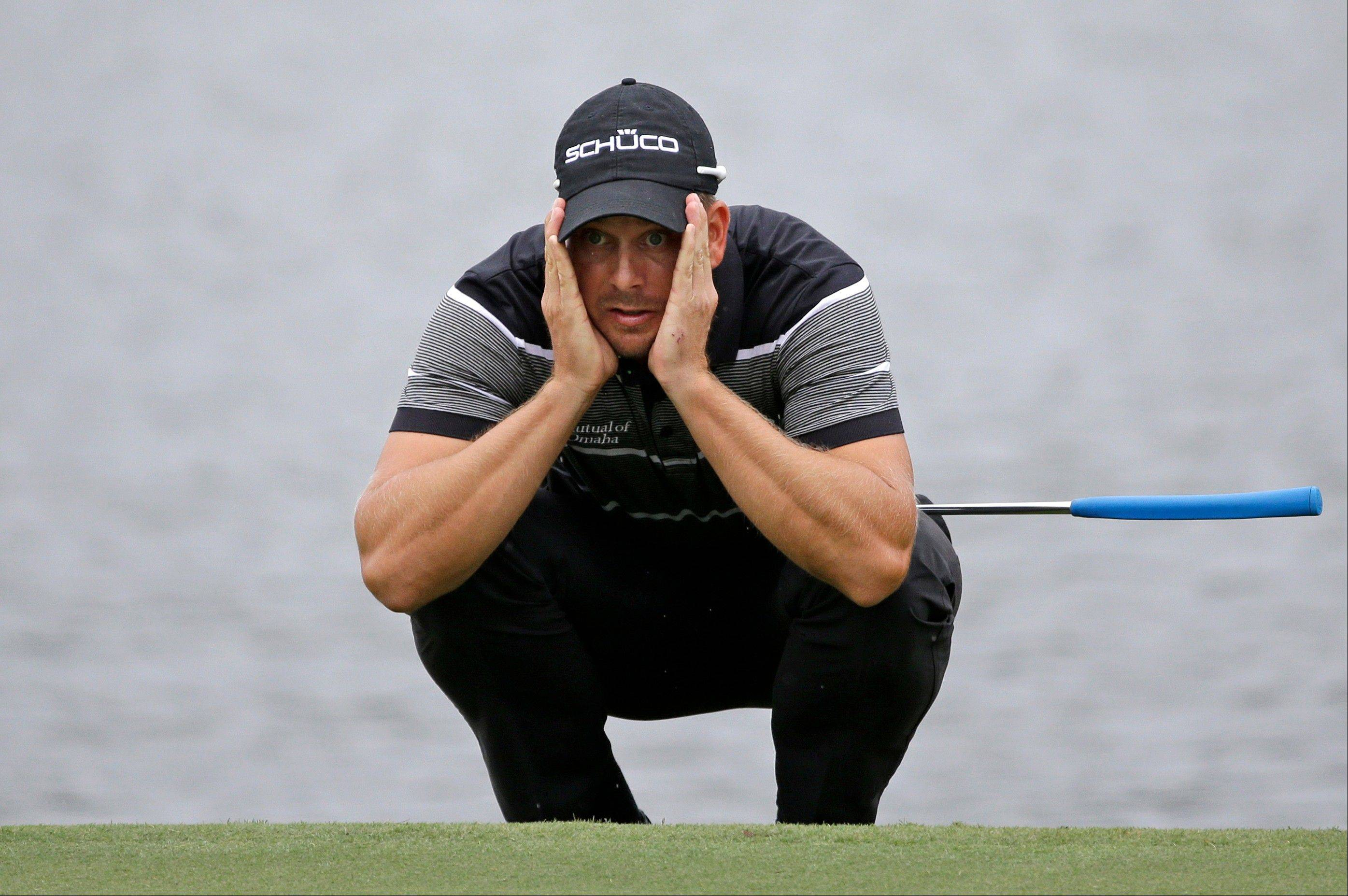 Henrik Stenson eyes his putt on the sixth hole Saturday at the Tour Championship at East Lake Golf Club in Atlanta.