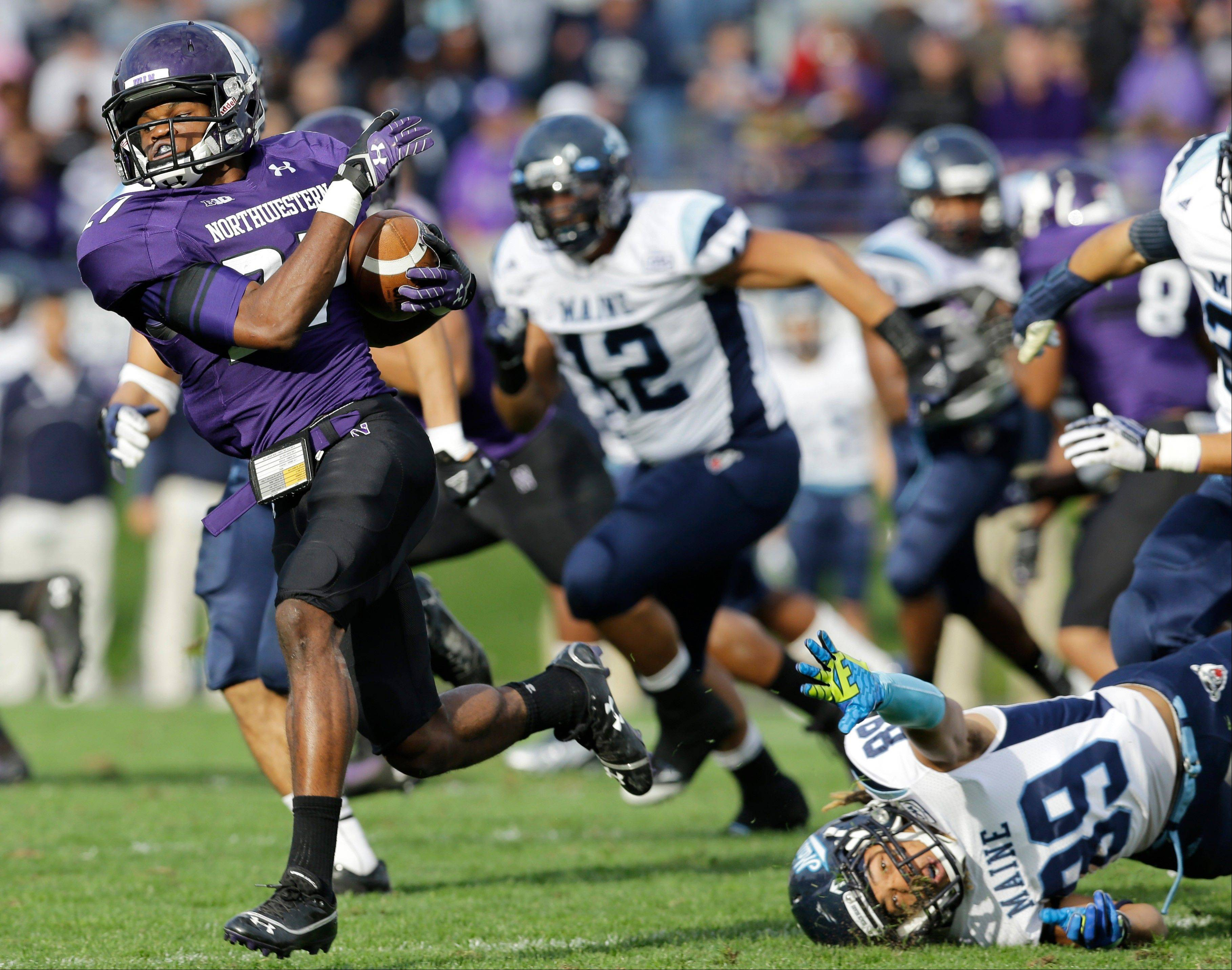 Northwestern cornerback Matthew Harris runs with the ball past Maine wide receiver Arthur Williams (89) during the second half of Saturday�s game in Evanston.