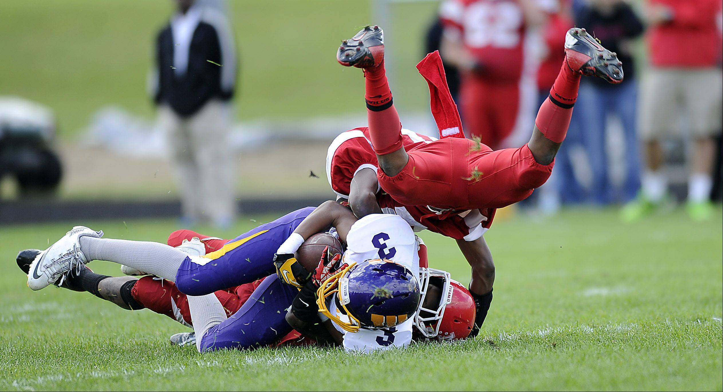 Wauconda�s Josh Anderson is tackled by Tazari Bryant for short yardage in the first half of varsity football at North Chicago High School on Saturday.