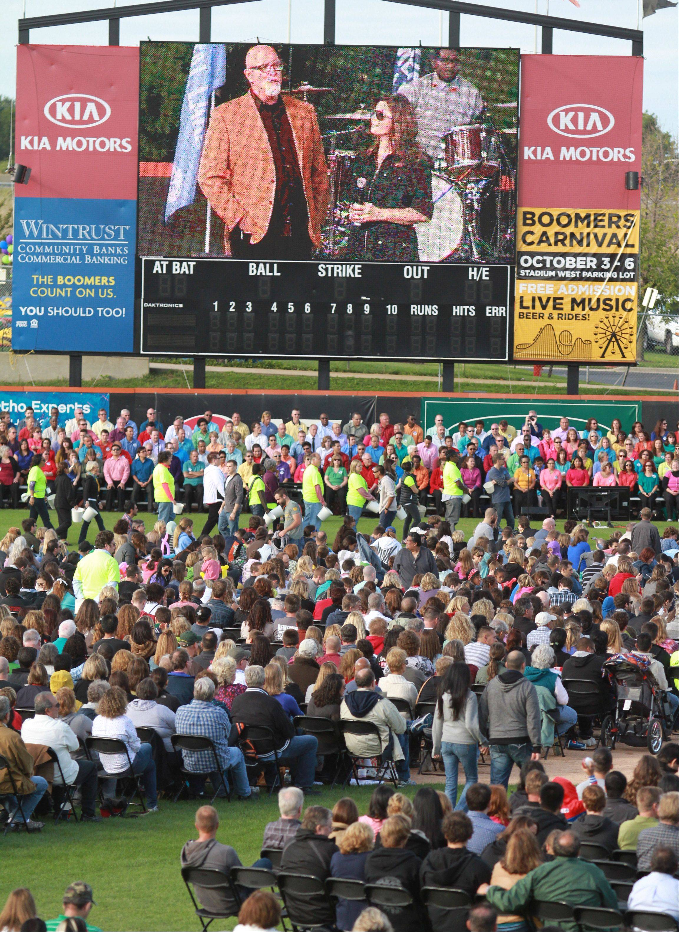 James and Kathy MacDonald speak at Harvest Bible Chapel's 25th anniversary celebration Saturday at Boomers Stadium in Schaumburg. James MacDonald is the chapel's founding senior pastor.