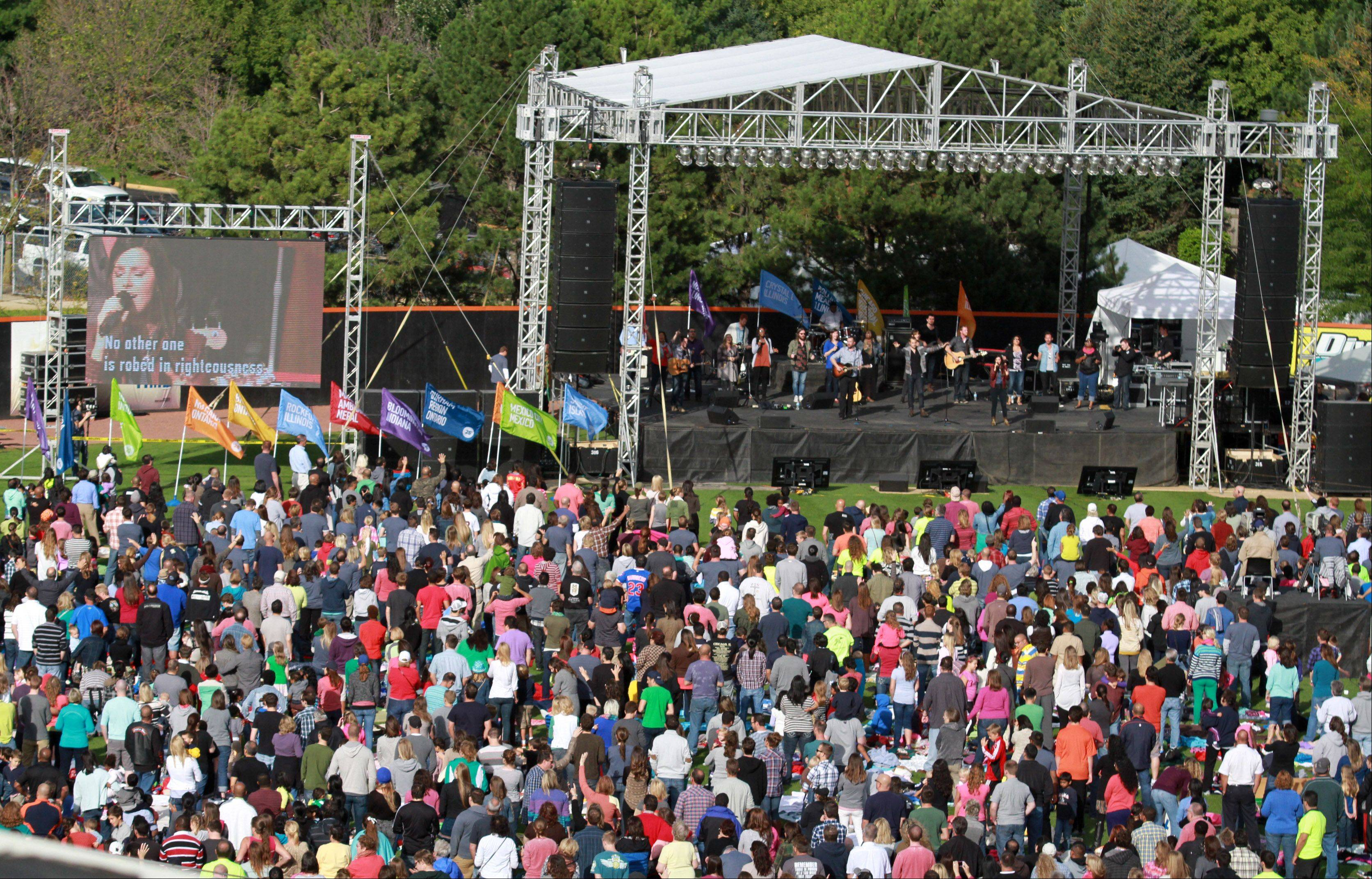 Roughly 3,000 worshippers listen to the Vertical Church Band at Harvest Bible Chapel's 25th anniversary celebration Saturday at Boomers Stadium in Schaumburg.