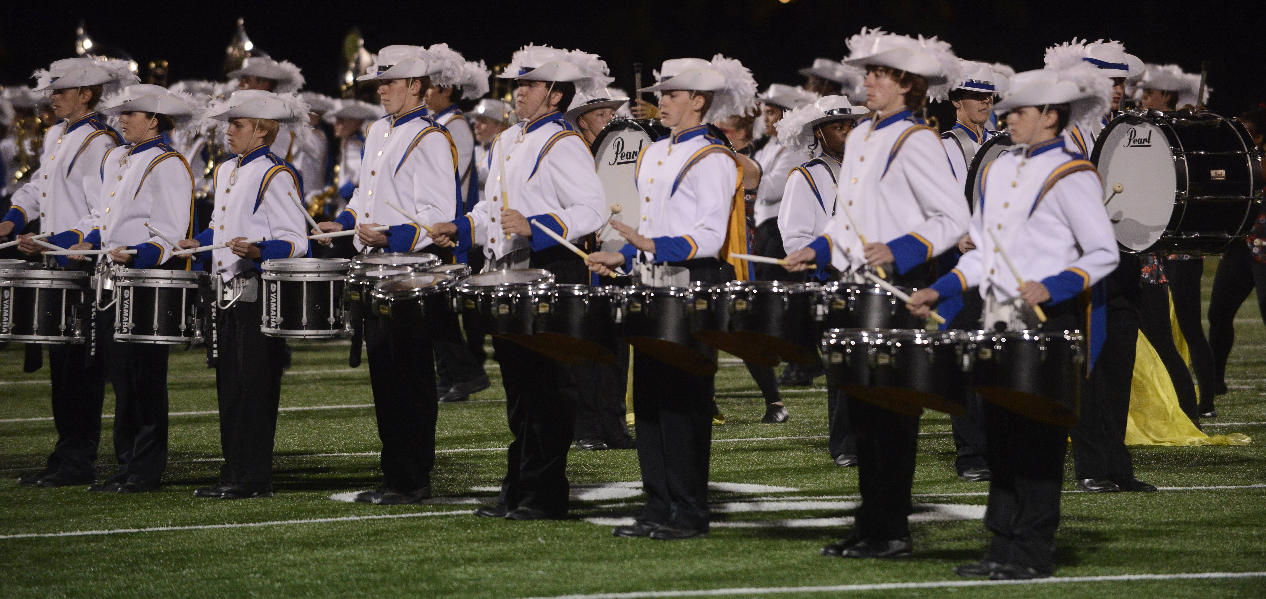 The Warren High School Marching Band performs during the annual Chicagoland Marching Band Festival at Wheeling High School Saturday.