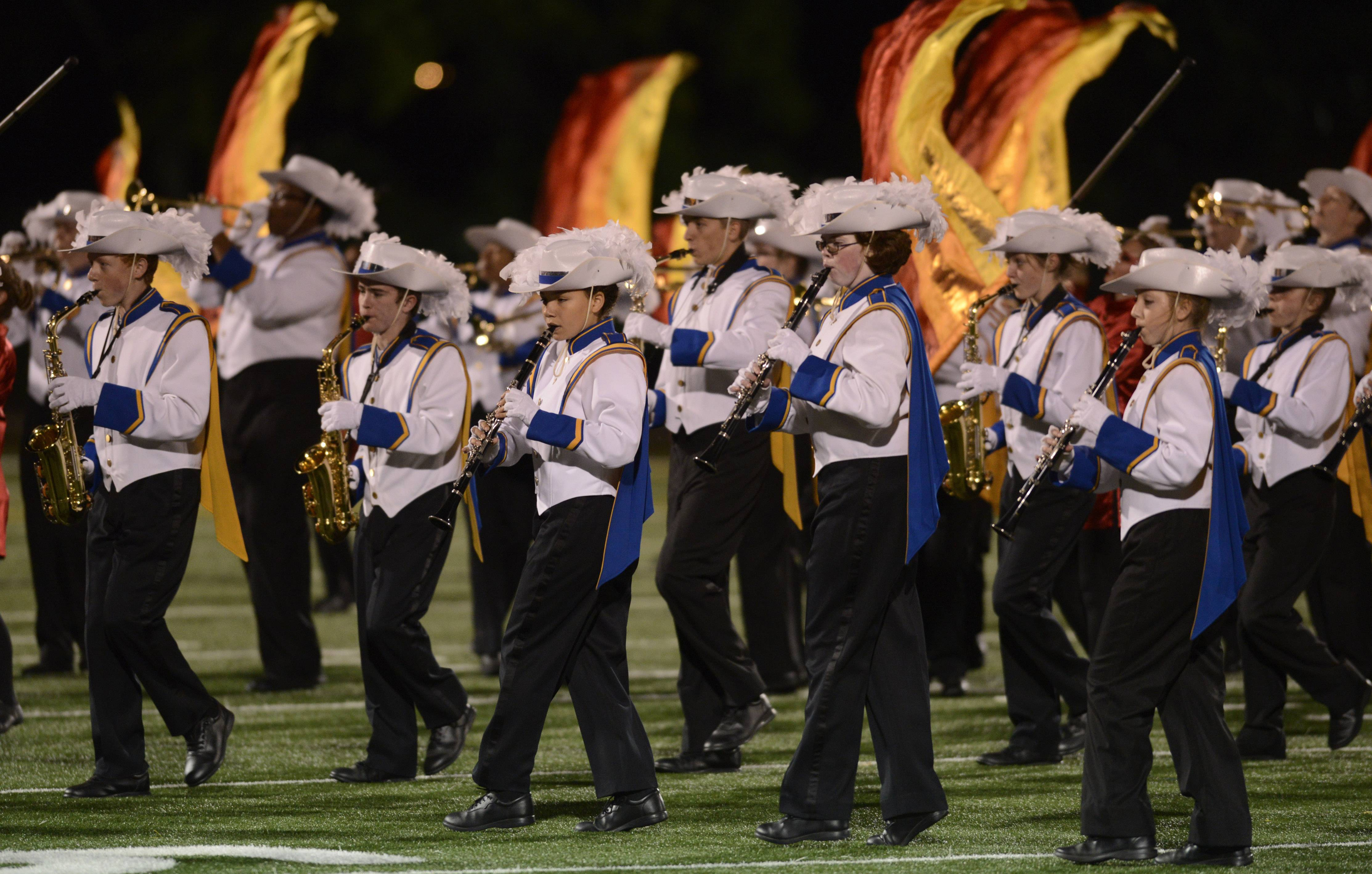 The Warren High School Marching Band performs Saturday during the annual Chicagoland Marching Band Festival at Wheeling High School .